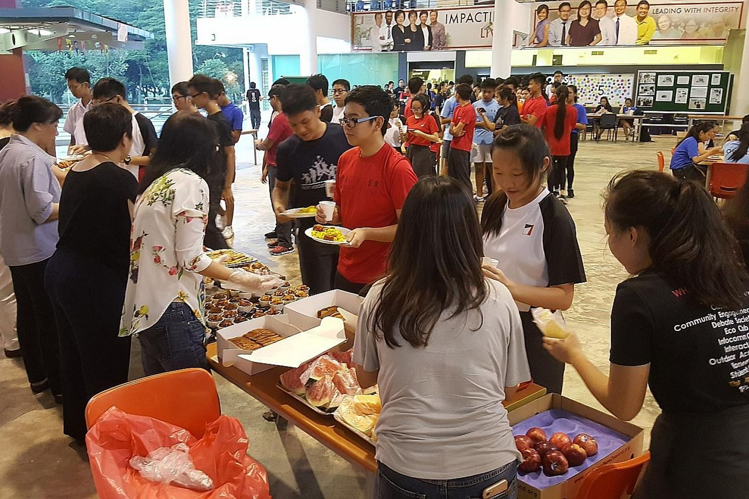 Pioneer Junior College students enjoy not just a conducive environment in school to study at night ahead of the year-end examinations, but also food which is brought and served by parents. Up to 250 students will head down to the school for its night