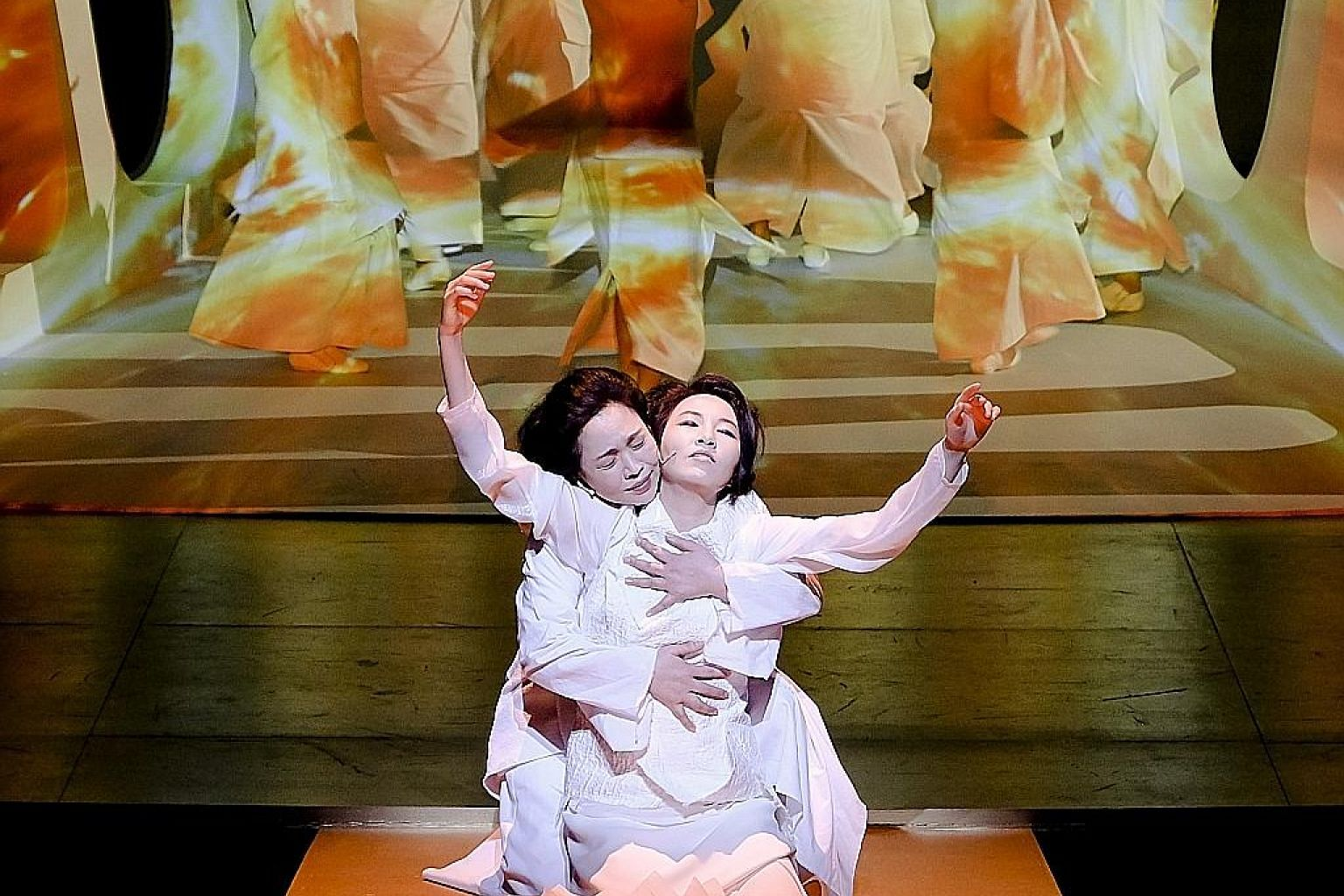 Yi So Yeon (front) as Cassandra, embraced by Kim Kum Mi, who plays her mother, Hecuba, in Trojan Women.