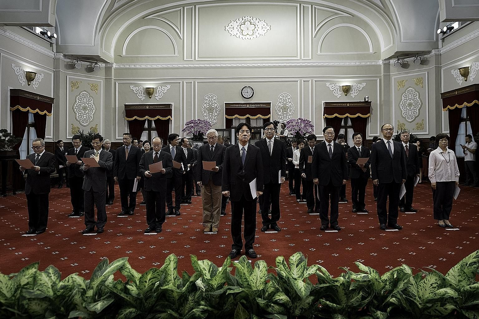 Taiwan's newly appointed Premier William Lai Ching-te (centre) with his Cabinet during yesterday's inauguration.