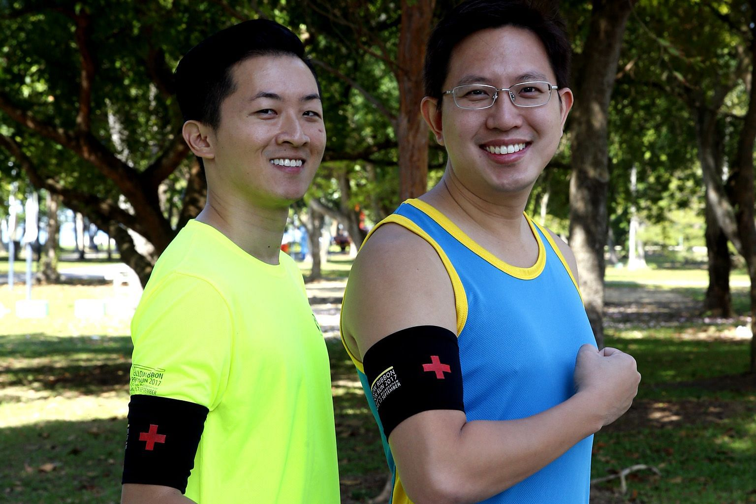 Nurse manager Loh Lip Chiang, 38 (left), and Dr Henry Chua, 34, who both work for healthcare provider Parkway Pantai, are among the first aiders who will run with black armbands at the Yellow Ribbon Prison Run.