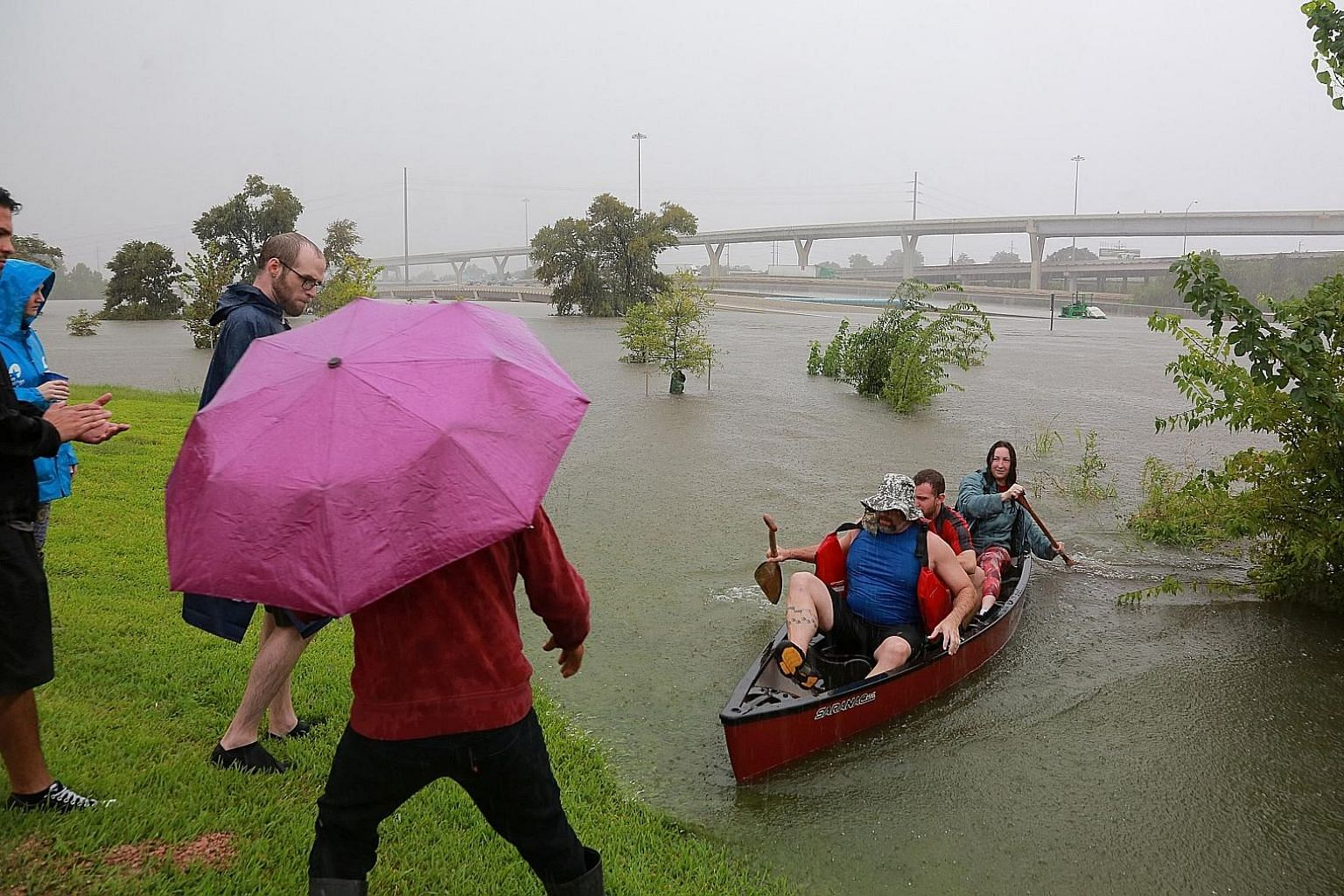 Residents using a kayak to rescue motorists stranded on a highway that was submerged amid widespread flooding caused by Hurricane Harvey last month in Houston, Texas. It took a flooding crisis, says the writer, to join people into one interconnected,