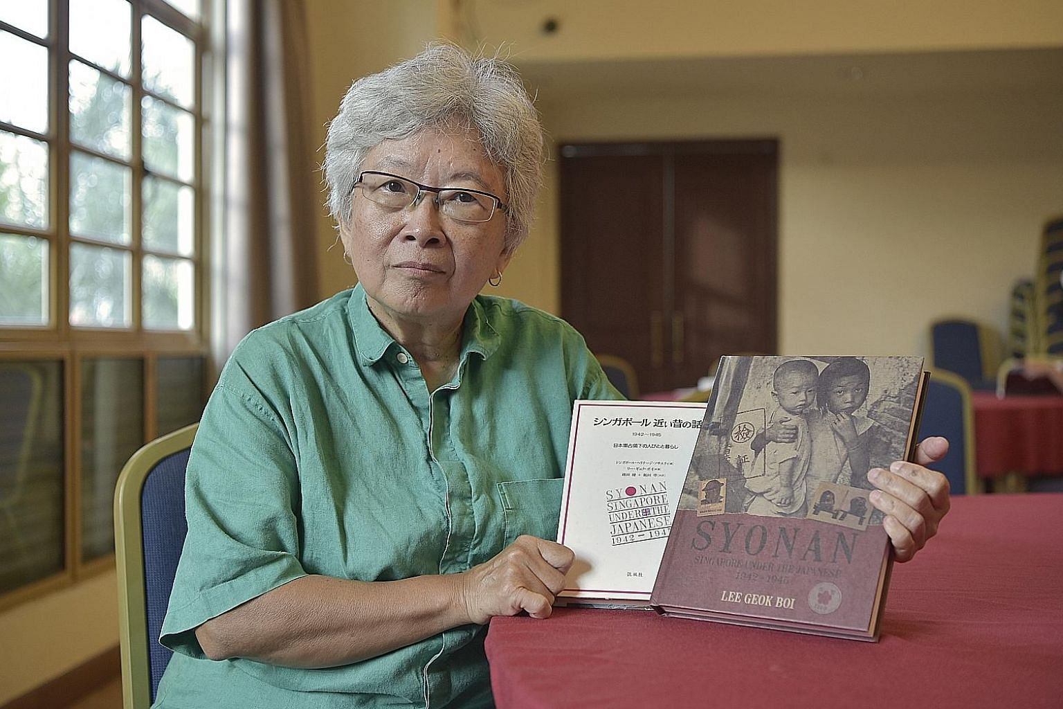 A chronicler of the Japanese Occupation, Lee Geok Boi (above) has launched the second edition of her 1992 book, Syonan, to commemorate the 75th anniversary of the fall of Singapore.