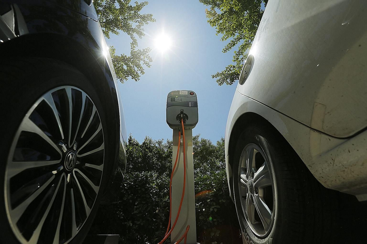 An electric vehicle charging point in Beijing. China's government is working on a timetable to ban petrol and diesel cars.