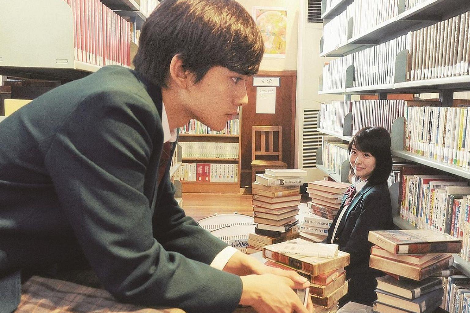 Minami Hamabe and Takumi Kitamura in Let Me Eat Your Pancreas.