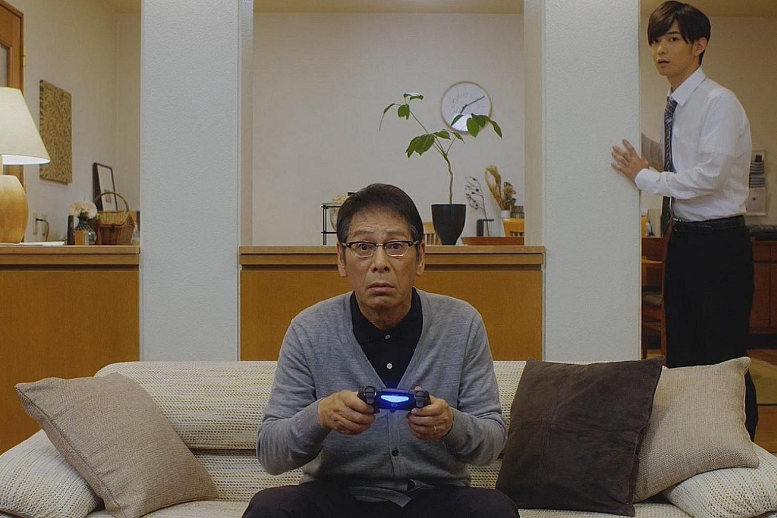 A father (Ren Osugi) and a son (Yudai Chiba, both above) reconnect with each other through an online role- playing game in Final Fantasy XIV Dad Of Light.