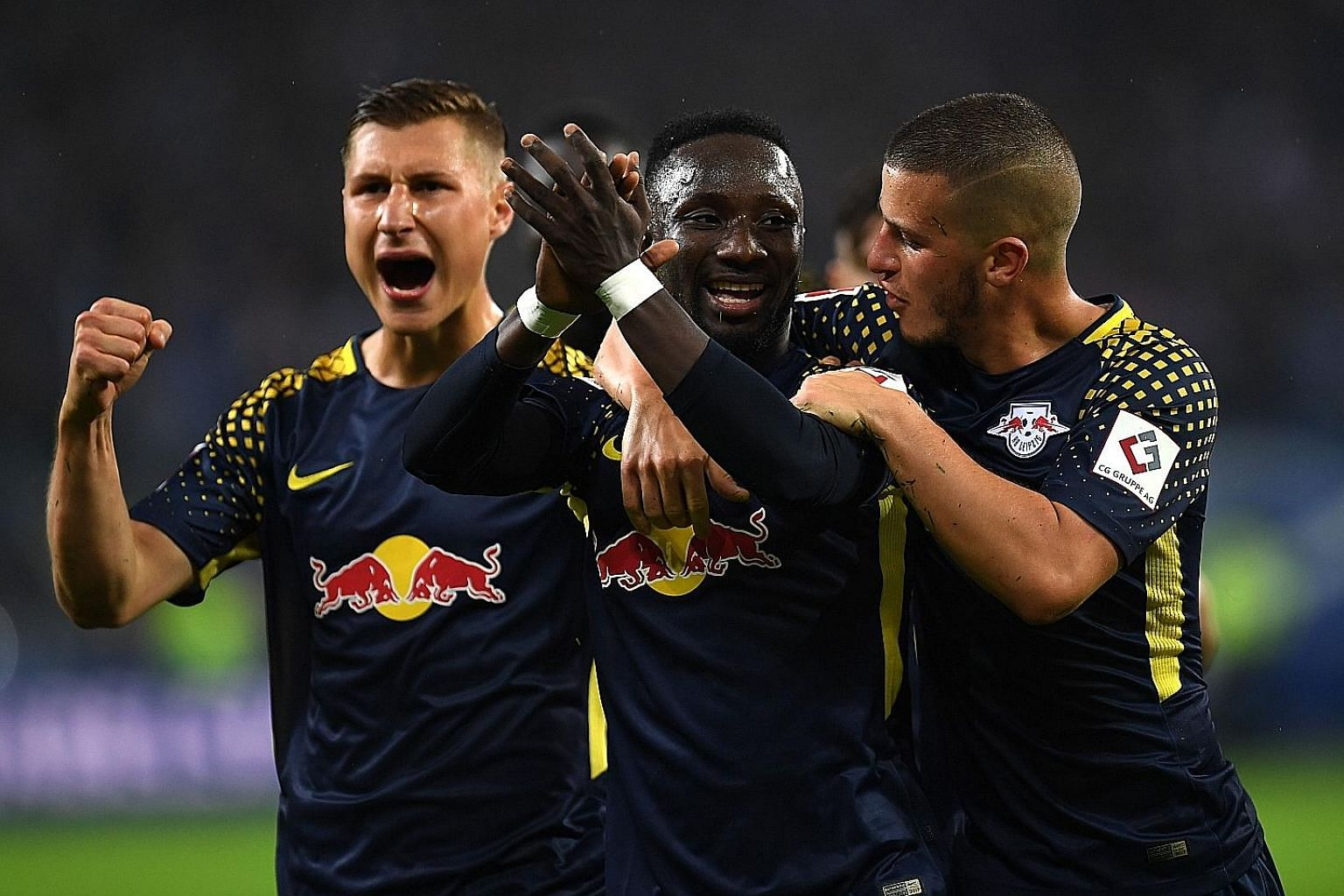 RB Leipzig's Naby Keita (centre) and his team-mates celebrating his opener against Hamburg last Saturday. This will be Leipzig's first Champions League outing.