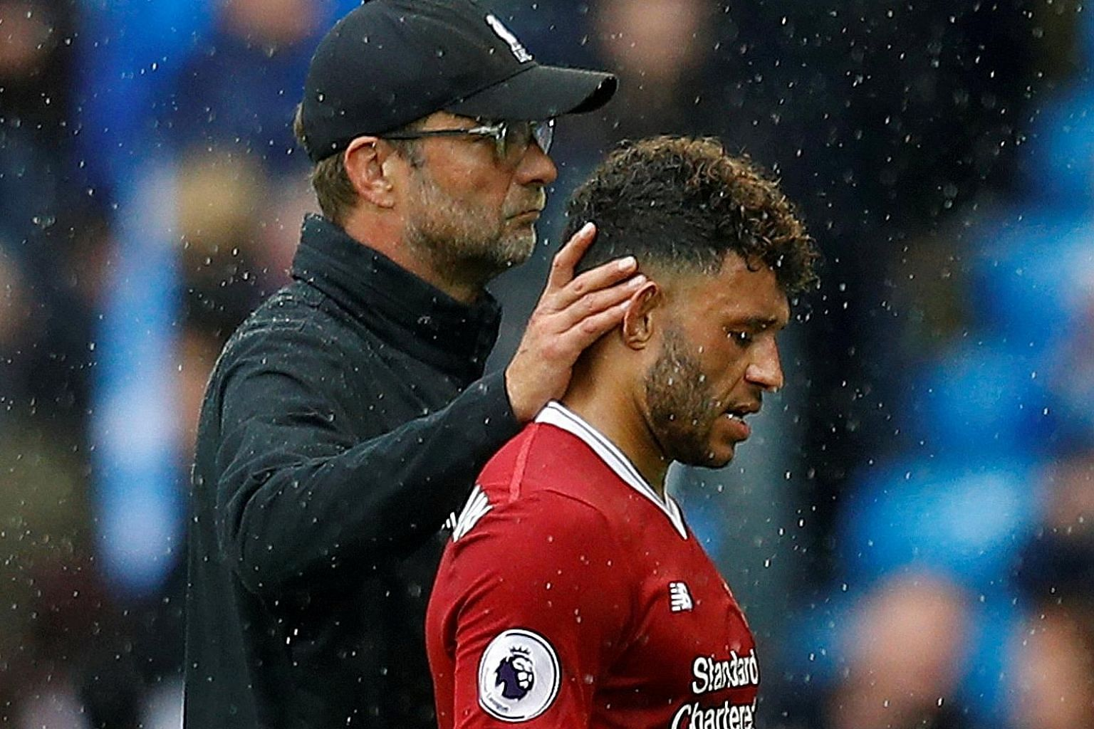 Liverpool manager Jurgen Klopp consoles Alex Oxlade- Chamberlain after the 5-0 defeat against Manchester City last Saturday.