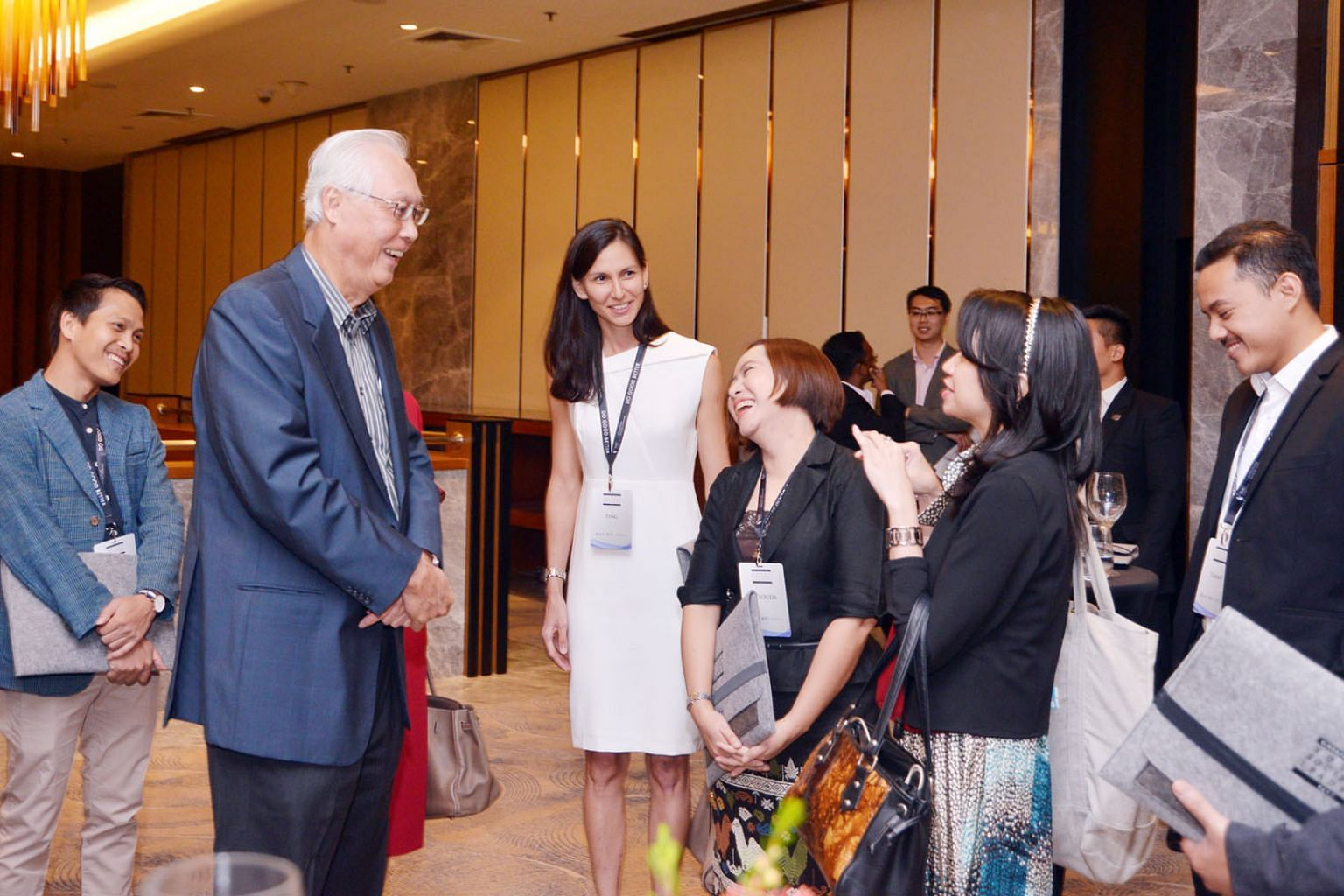 Emeritus Senior Minister Goh Chok Tong speaking with some participants of the inaugural Singapore Summit Young Societal Leaders Programme yesterday.