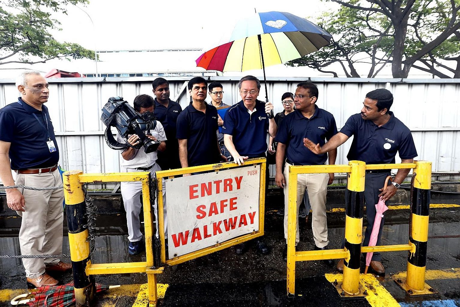 Minister of State for Manpower Sam Tan looking at a pedestrian safety door at NatSteel yesterday, during the launch of the Drive Safe, Work Safe campaign.