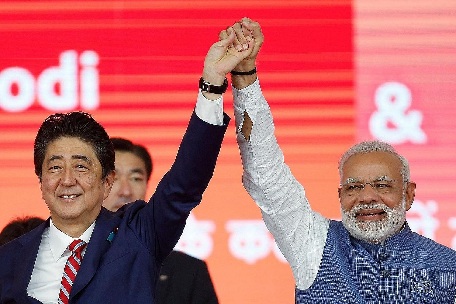 Japanese Prime Minister Shinzo Abe and his Indian counterpart, Mr Narendra Modi, after the ground-breaking ceremony for the high-speed rail project in Ahmedabad, India, yesterday. The $22.8 billion undertaking is expected to boost India's ageing rail