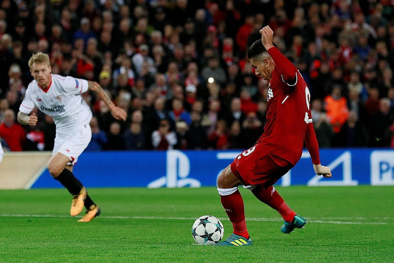 Roberto Firmino attempting to put Liverpool 3-1 up from a penalty just before half-time but his shot struck the post. It proved costly as Sevilla equalised late to rescue a point.