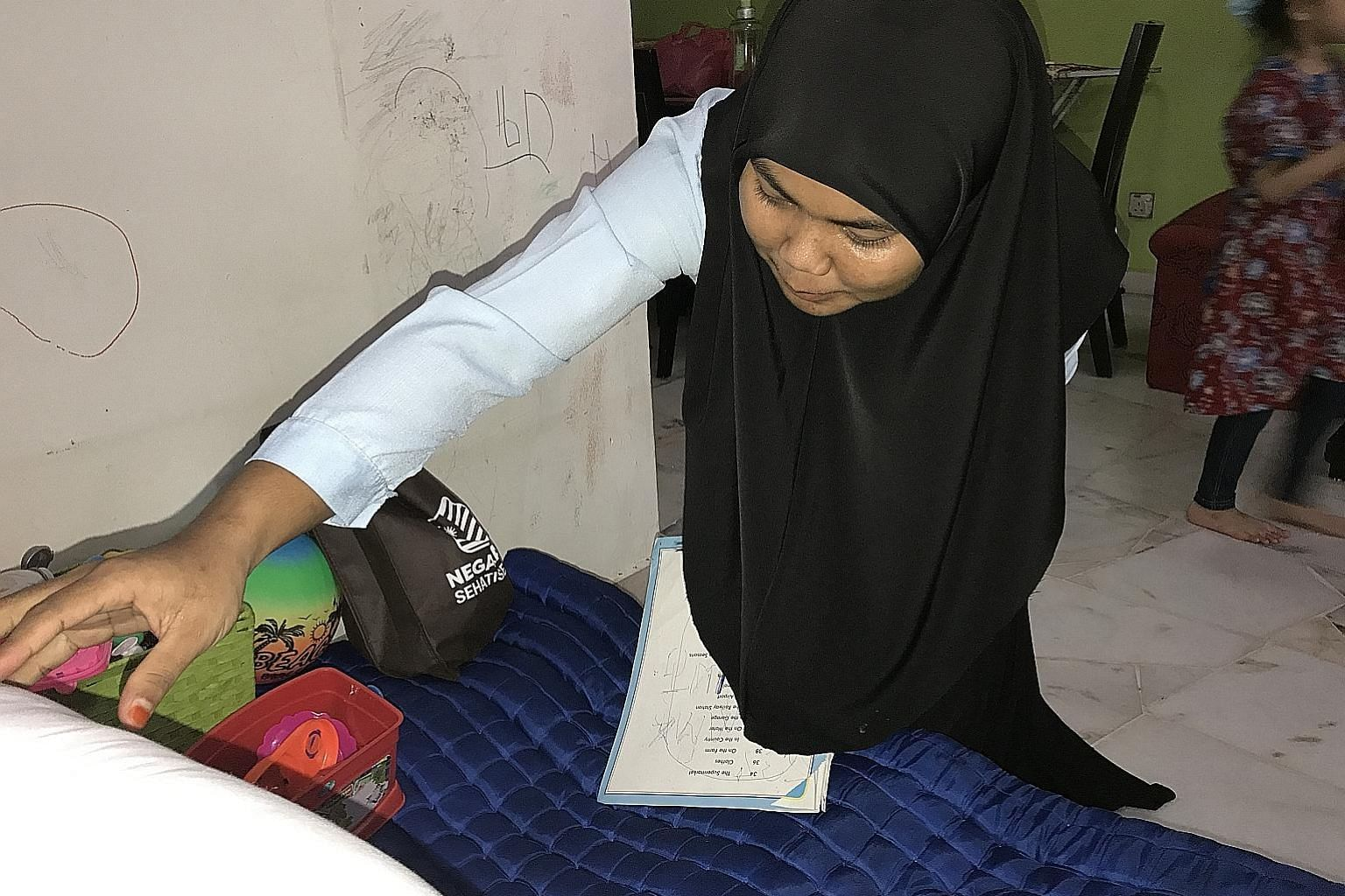 Ever since she started work two months ago, Ms Nor Asma has formed a strong bond with her employer's kids, especially Ahmad Willdan Arjuna Ahmad Fedtri, three. Ms Nor Asma Arifin, who was initially apprehensive about living with strangers, has adjust