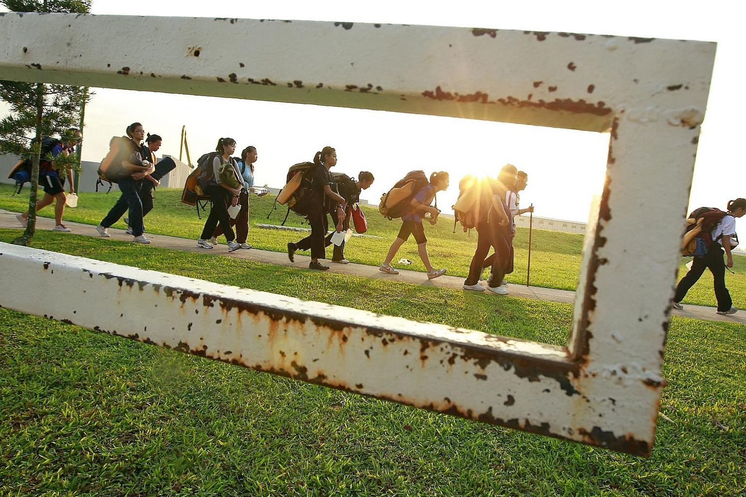Secondary 3 students on an urban land expedition in Punggol in 2011. Participants picked up leadership and navigational skills as they navigated through housing estates and the Lorong Halus Wetland.