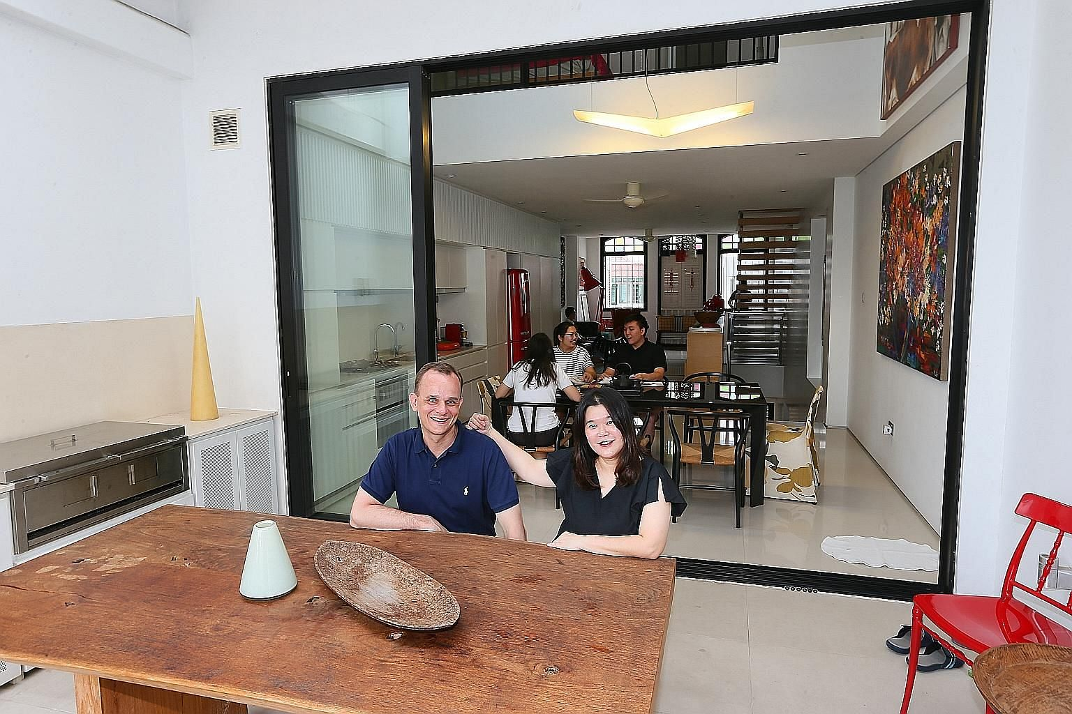 The National Library Building in Victoria Street, which won BCA's Green Mark Platinum Award in 2005, has features such as a gigantic air well in the middle that reduce the energy needed to cool the building. Ms Canny Teo and her husband, Mr Rick Reid