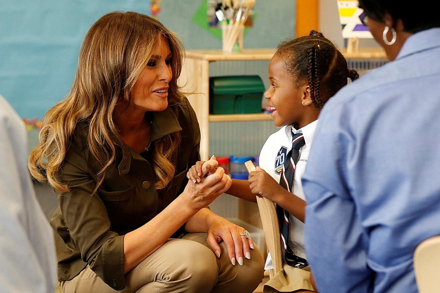 Mrs Melania Trump with a child at a youth centre at Joint Base Andrews in Maryland last Friday. She had travelled there in a show of support for military families. The United States First Lady is taking on a public schedule that is beginning to resem