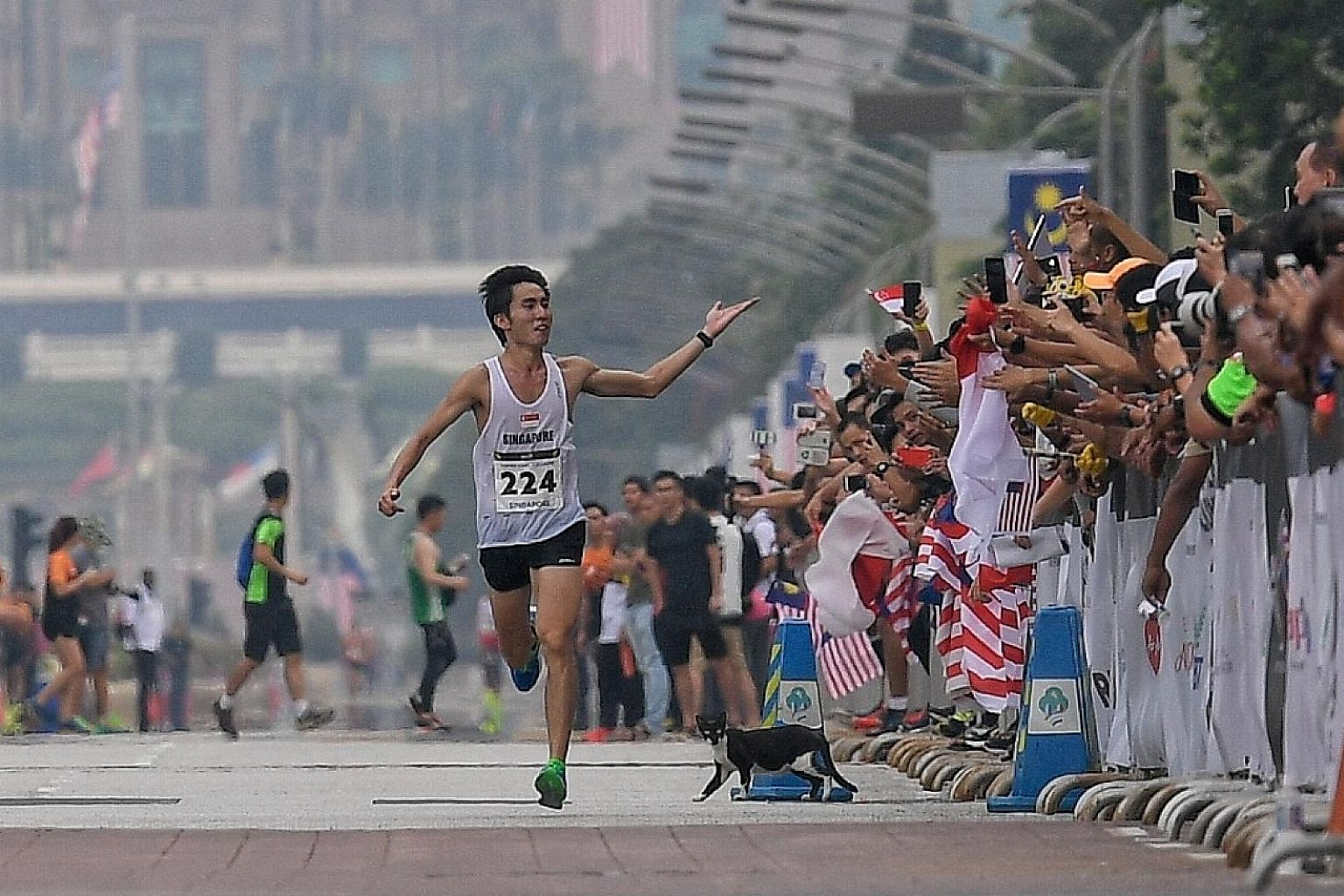 Singapore marathoner Soh Rui Yong at the finish line in Putrajaya last month, when he won his second successive gold medal at the SEA Games. He is protesting against the rule which requires him to give his association 20 per cent of the $10,000 award