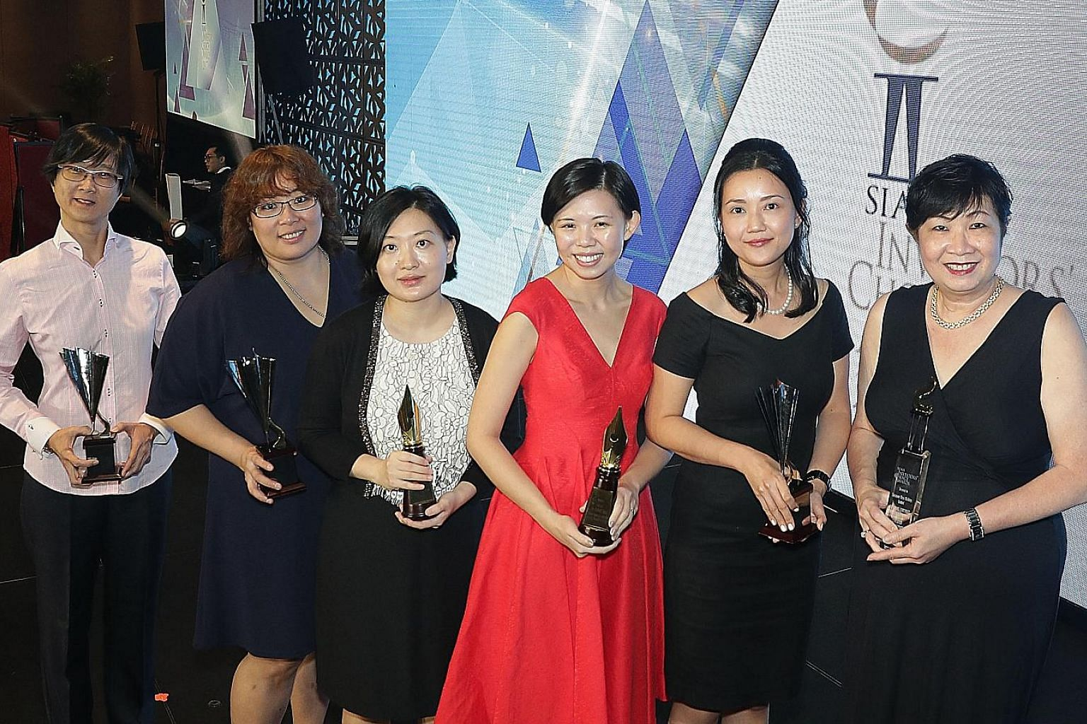 Award winners from SPH are (from left) Ms Quek Suzane, Lianhe Zaobao associate business editor; Ms Grace Leong, Straits Times correspondent; Ms Hu Yuanwen, Lianhe Zaobao correspondent; Ms Jamie Lee and Ms Claire Huang, both Business Times corresponde