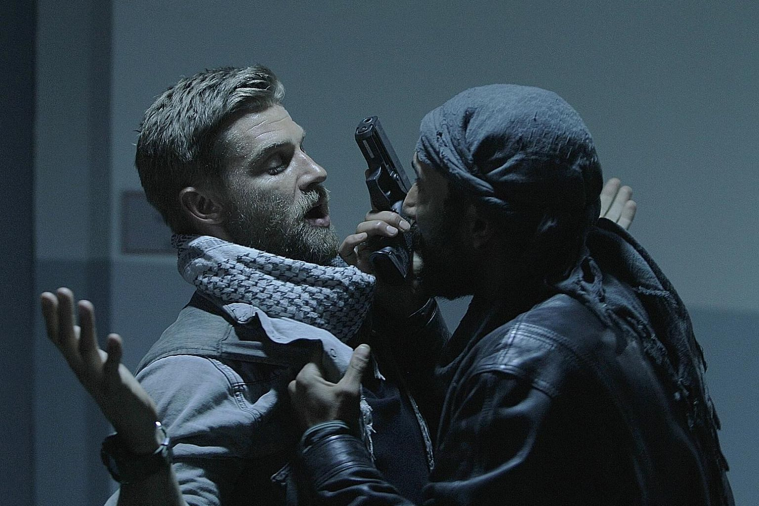 Mike Vogel (far left) stars as an officer leading a team on a mission to rescue a kidnapped eye surgeon in The Brave.