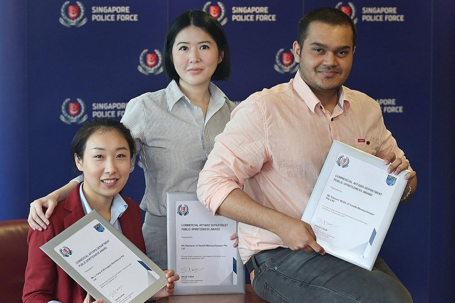 (From left) Ms Li Fang from Zhongguo Remittance, and Ms Novianti and Mr Sameer Malik from Samlit Moneychanger. At both firms, a customer had wanted to remit a large sum of money to China, but the staff members noticed that something was wrong and cal