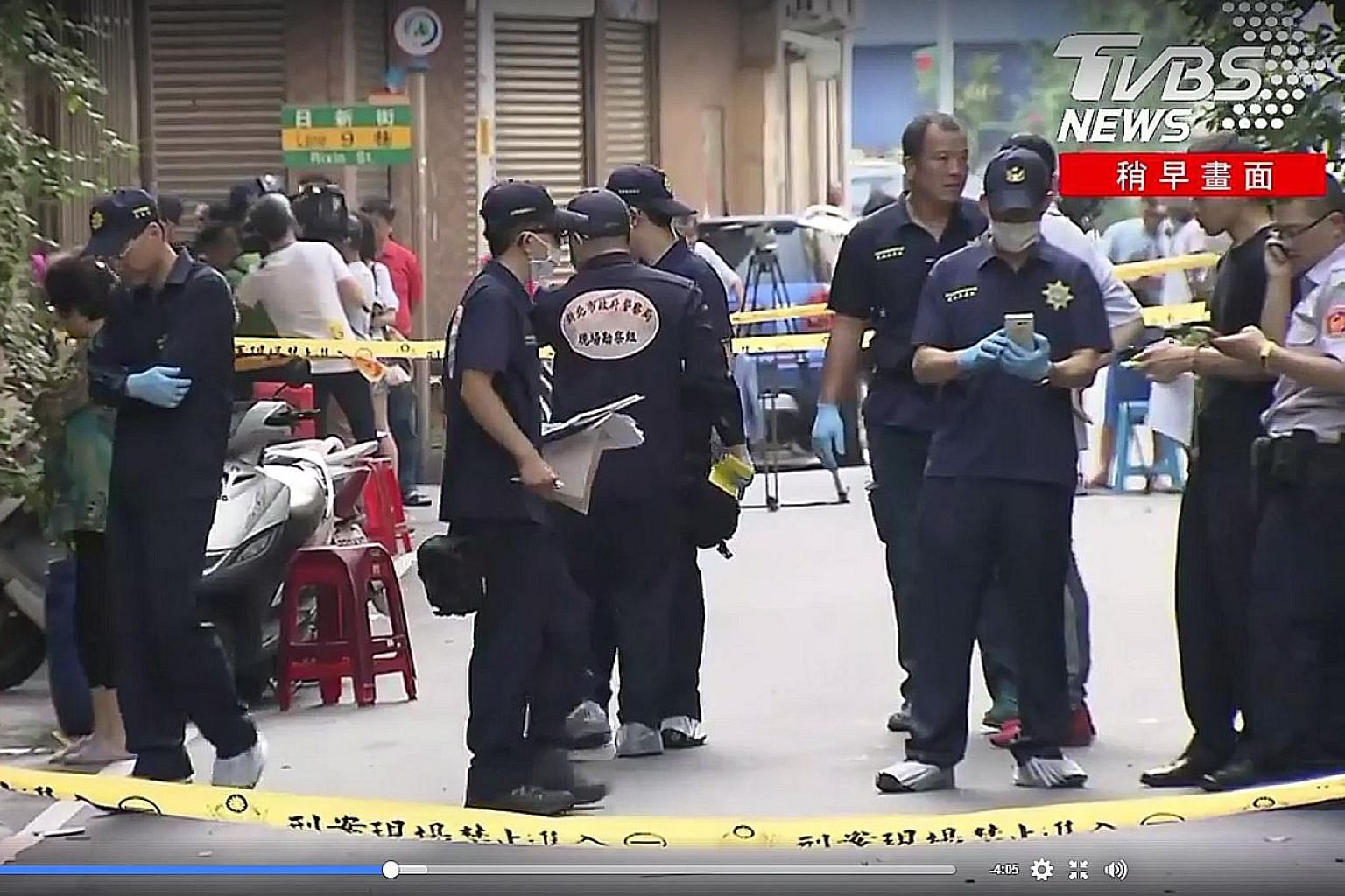 "Taiwanese police at the scene of the shooting incident yesterday. The suspect said he was seeking revenge for his ""boss""."