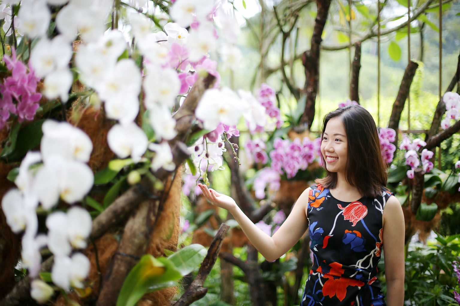 Ms Livia Chng at the Singapore Botanic Gardens. The 29-year-old last year set up Refresh Flowers, a social initiative that turns flowers used in weddings into bouquets for patients undergoing palliative care. It currently works with Assisi and HCA ho
