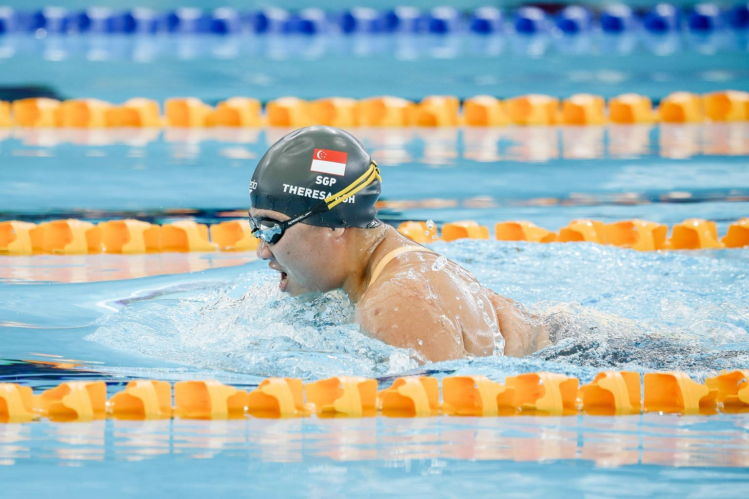 Theresa Goh on her way to winning the SB4 100m breaststroke at the Kuala Lumpur Asean Para Games yesterday. She clocked 2min 4.16sec to win the race, more than 24 seconds ahead of Danh Thi My Thanh of Vietnam, who was second with a time of 2:28.24.