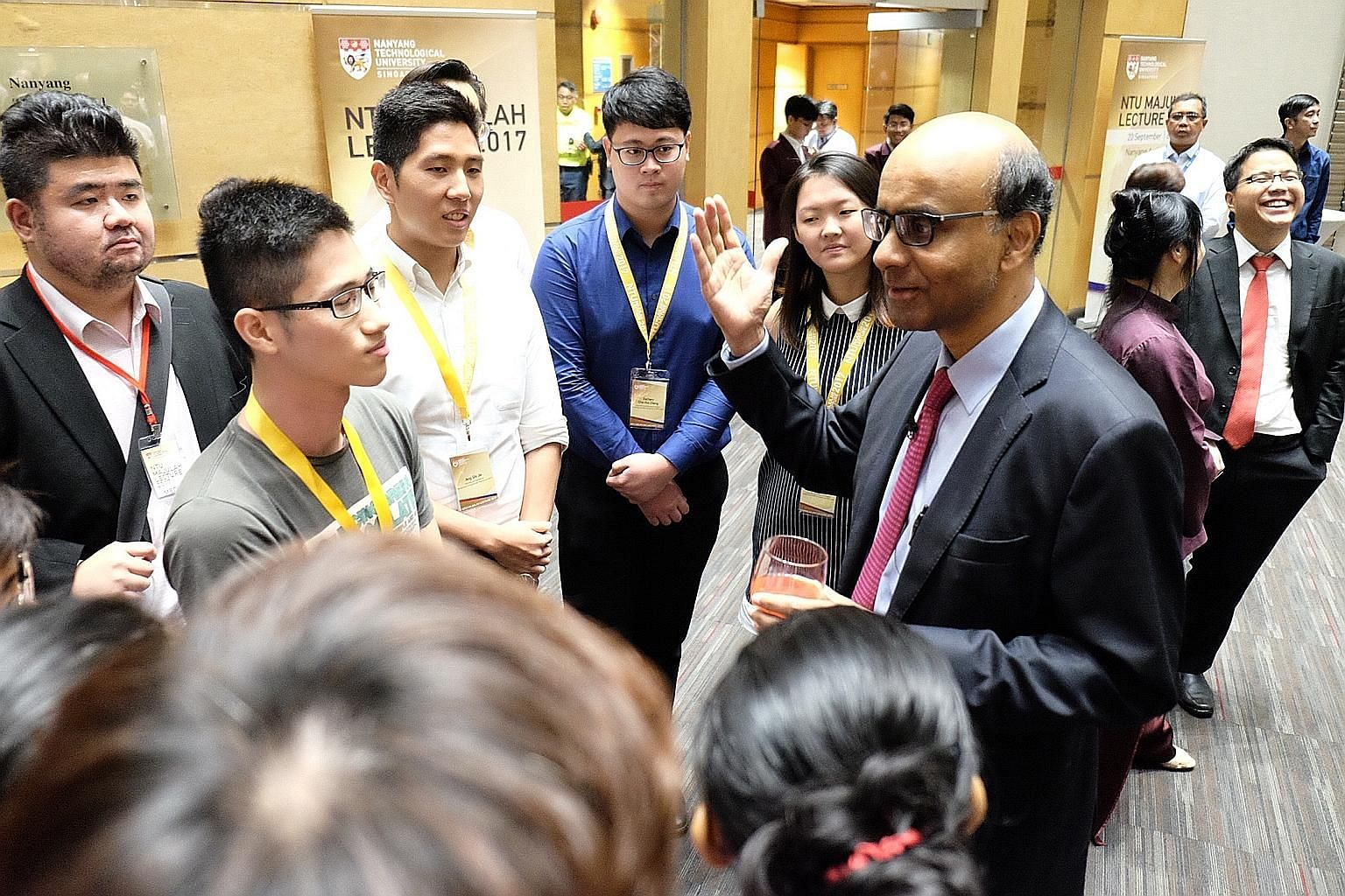Deputy Prime Minister Tharman Shanmugaratnam having a chat with Nanyang Technological University students after the inaugural Majulah Lecture. In his nearly one-hour-long speech, he said the education system must keep changing and experimenting, or i