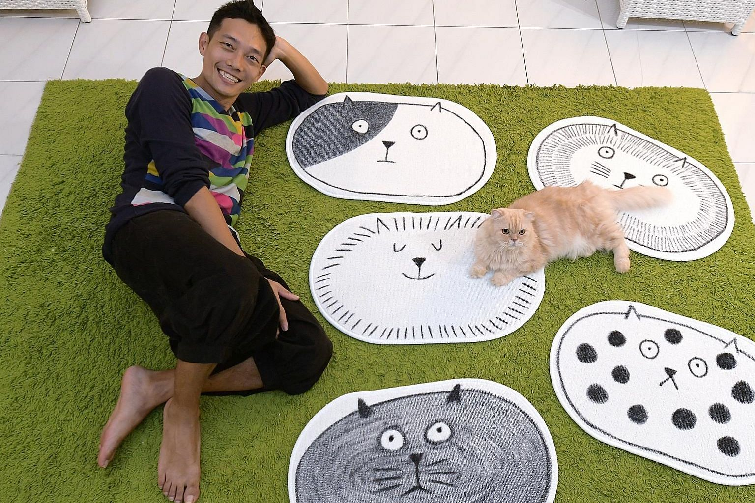 Left: Soh Ee Shaun's bath mats with cat faces are artworks for felines to interact with. Above: Artist Adeline Tan, aka Mighty Yellow, with her dog, which will be featured in her installation A Whole New World.