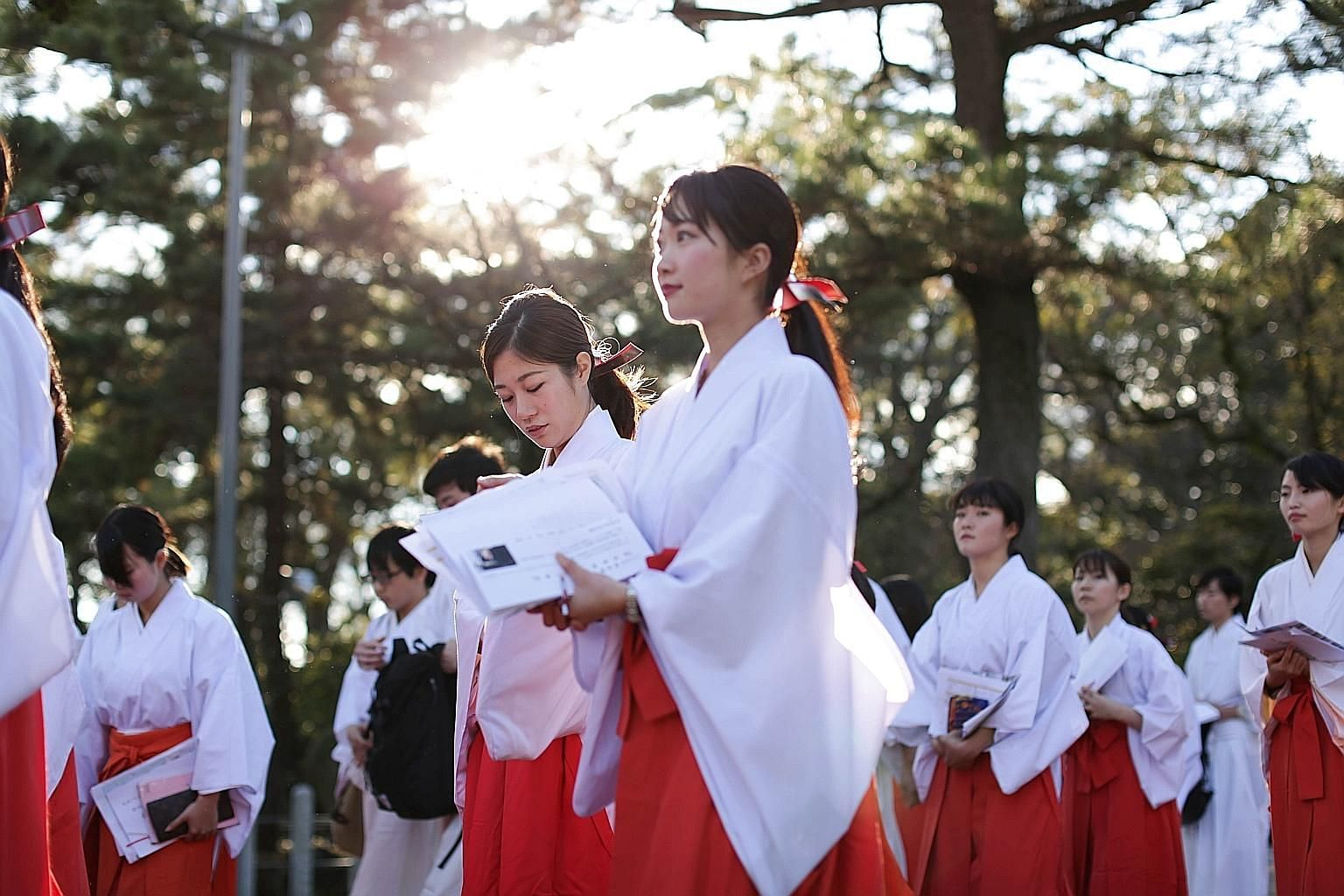 """Being an Honestbee """"bee"""" is popular among housewives, students, freelancers and young workers. And nearly 100 women (left) underwent training last December to be a part-time """"miko"""" or Shinto priestess for Nishinomiya Shrine's New Year events. Left: A"""