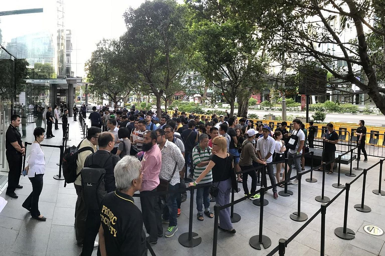 Mr Amin Ahmed Dholiya was first in the queue, having arrived at the store at around 7pm on Thursday. It was his first time queueing overnight for something, he said. He returned home last night. The queue outside Apple Orchard Road at 7.32am yesterda