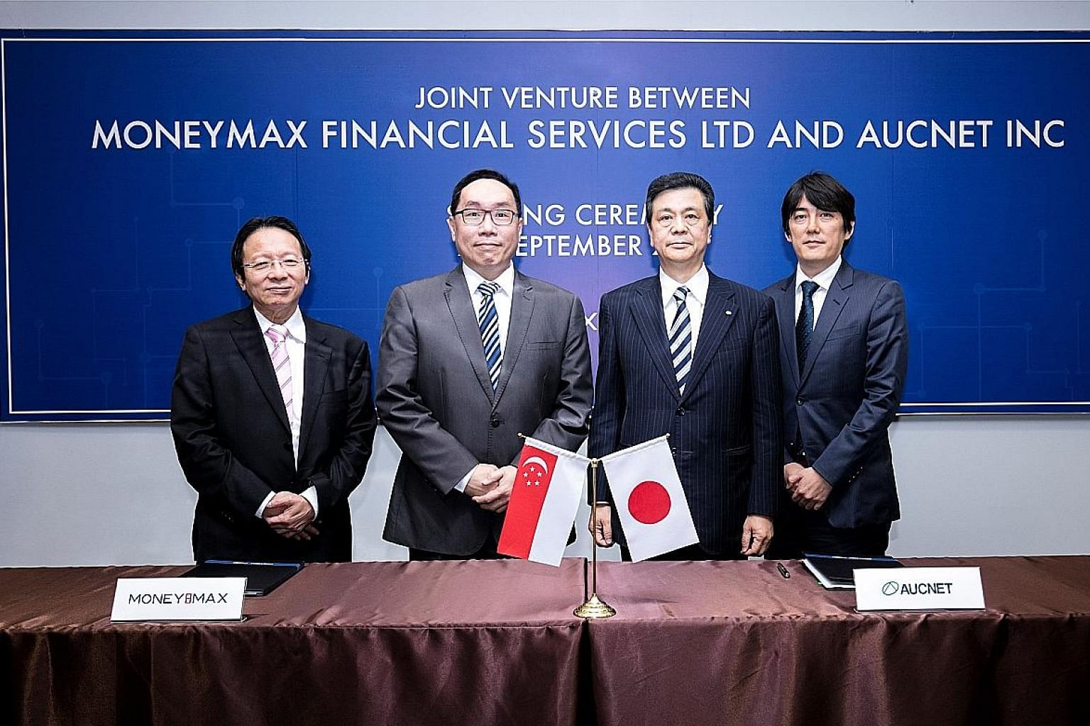 At the signing ceremony are (from left) International Enterprise Singapore senior adviser Chua Taik Him,MoneyMax chief executive Lim Yong Guan, Aucnet president Kiyotaka Fujisaki, and Mr Takashi Nakagawa, deputy managing director at Japan External Tr