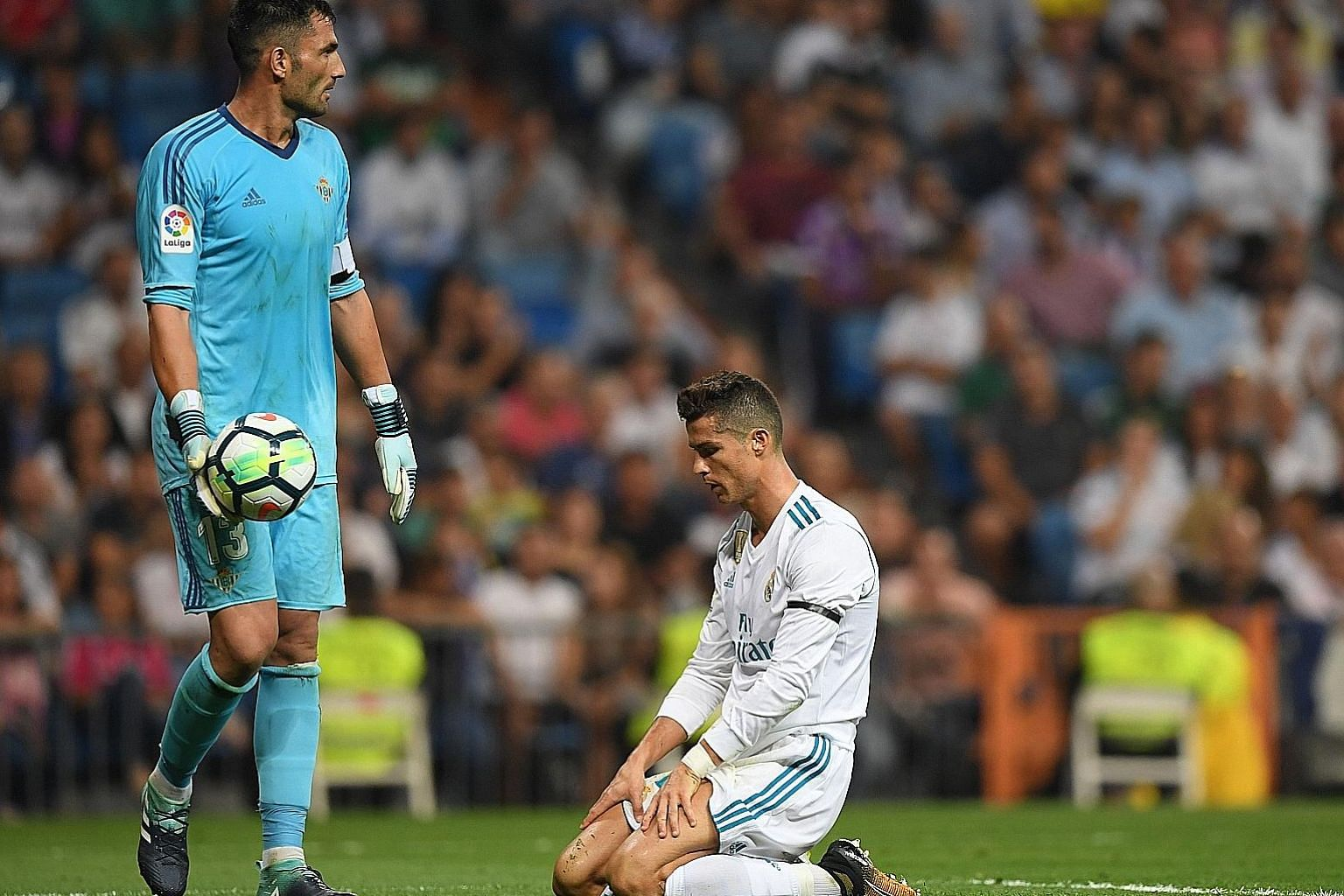 Portuguese star Cristiano Ronaldo is despondent after failing to beat Real Betis goalkeeper Antonio Adan in Real Madrid's 0-1 loss at the Santiago Bernabeu on Wednesday. It was the first time in 74 games that Real, who are a lowly eighth in the LaLig