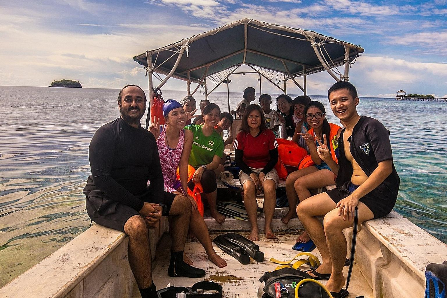Ms Chong Lee Ling (in red) leading a snorkelling trip to Indonesia's Togean Islands in August last year. 3Playgrounds' adventure tours are filled with sports and outdoor activities, such as rafting, cycling, trekking and horse-riding, and 70 per cent