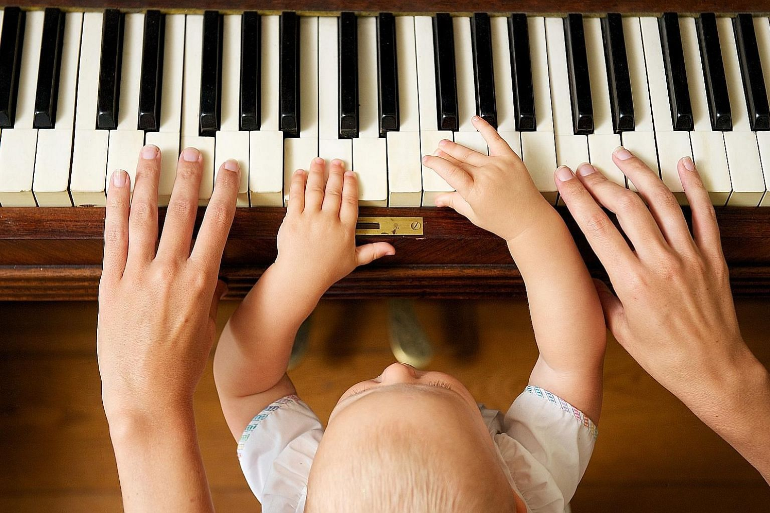 Don't be afraid to let your child see you sweat over a difficult task, such as mastering a piano score. It is beneficial as she will infer that she can succeed at something if she, too, tries hard enough.