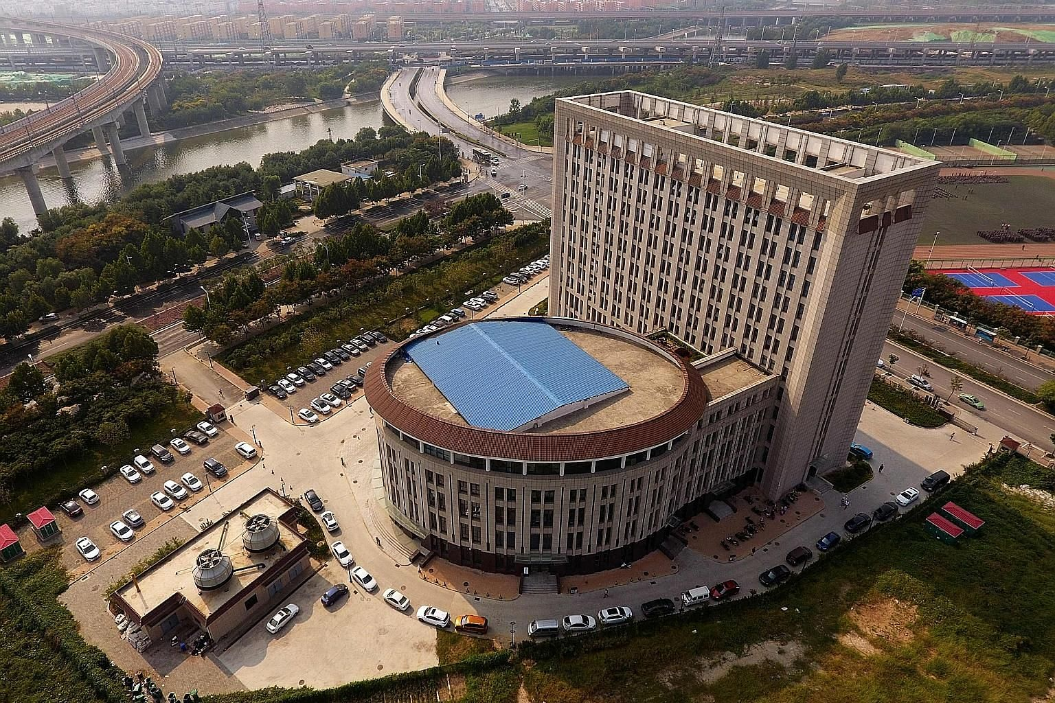 "This North China University of Water Resources and Electric Power building in Zhengzhou, Henan, has been mocked online as the ""Toilet Building""."