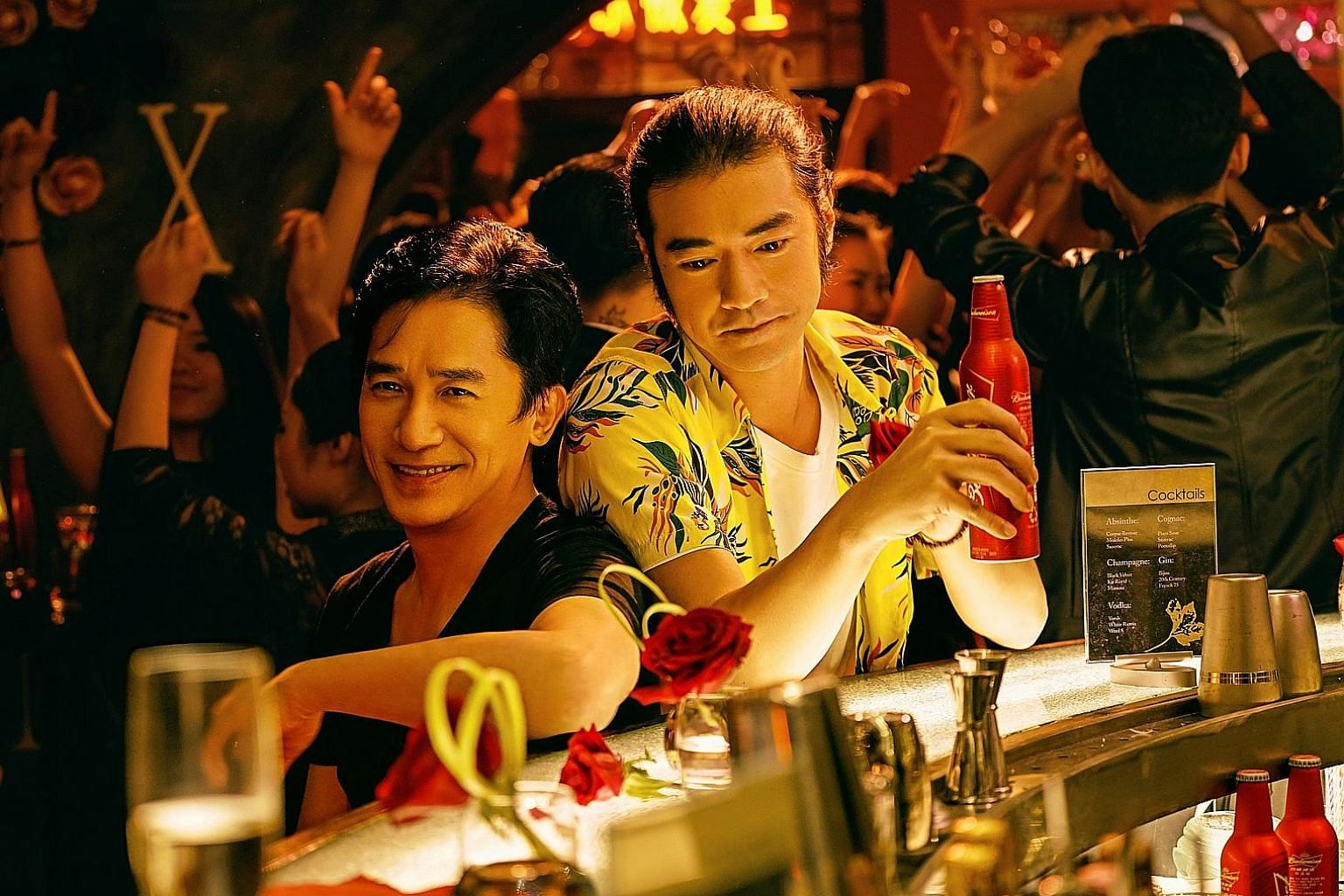 Takeshi Kaneshiro (right) with co-star Tony Leung Chiu Wai (left) in See You Tomorrow.