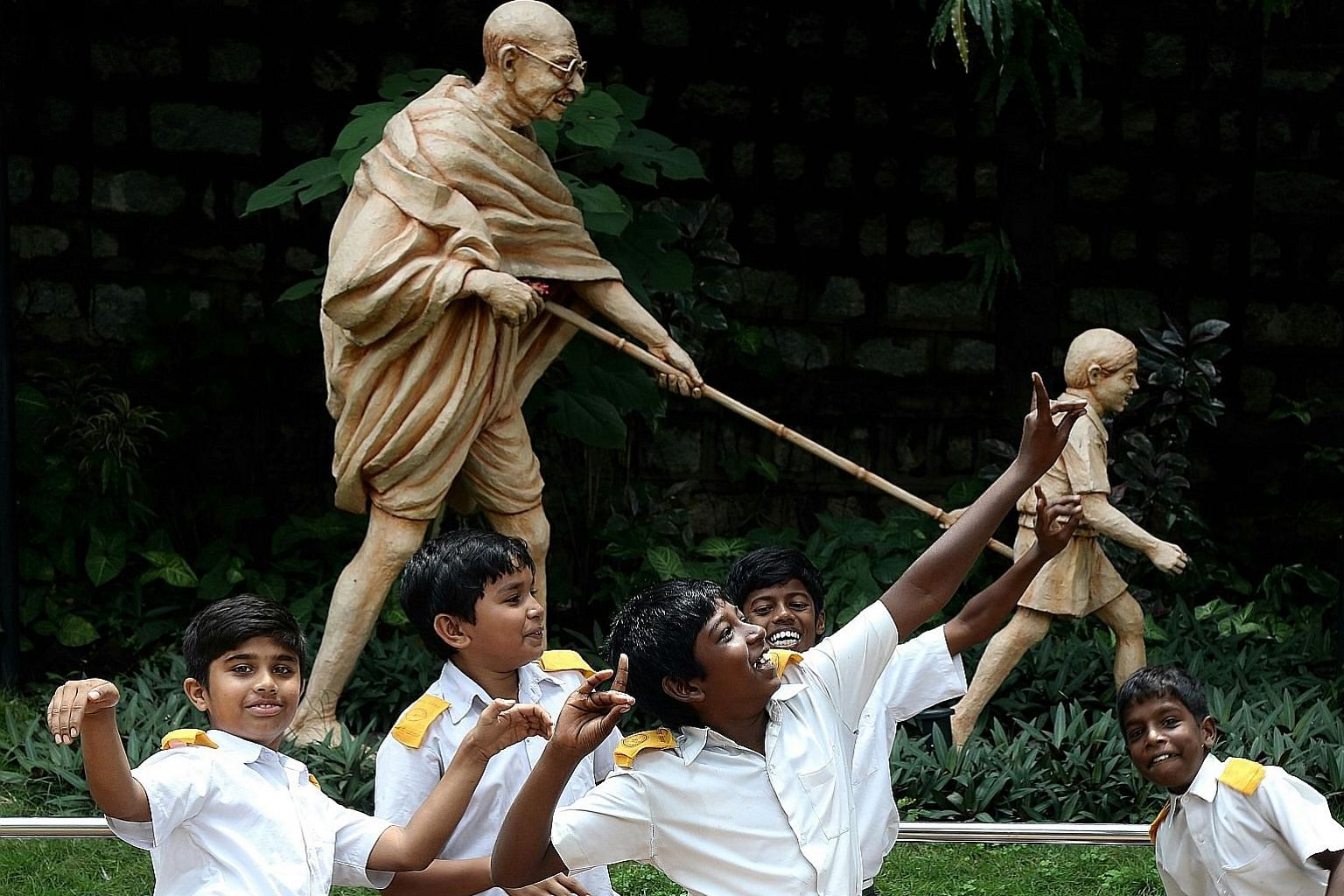 Indian students in Bangalore celebrating in front of a statue of Mahatma Gandhi on his 148th birth anniversary yesterday. Mohandas Karamchand Gandhi, also known as Bapu or Father of the Nation, was born on Oct 2, 1869, in Porbandar, Gujarat. He studi