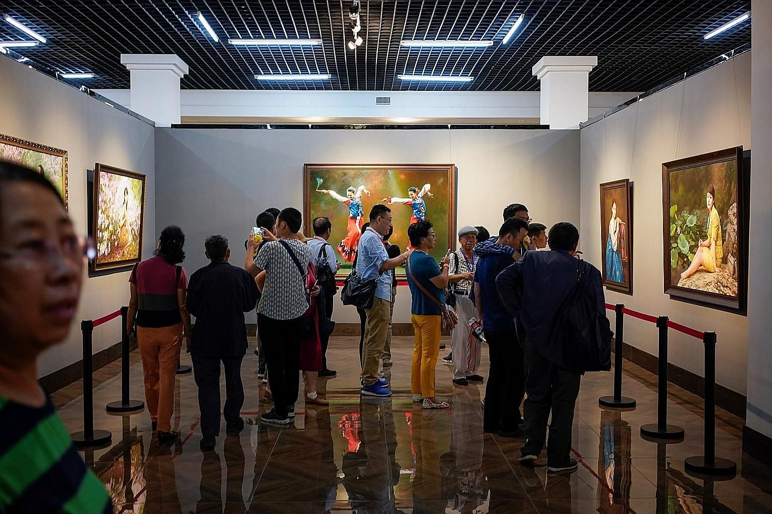 A gallery of paintings by North Korean artists at the China-North Korea Cultural Centre in Dandong, Liaoning province, China. Many galleries in the Chinese border city house North Korean painters, and their works are said to have sold for as much as