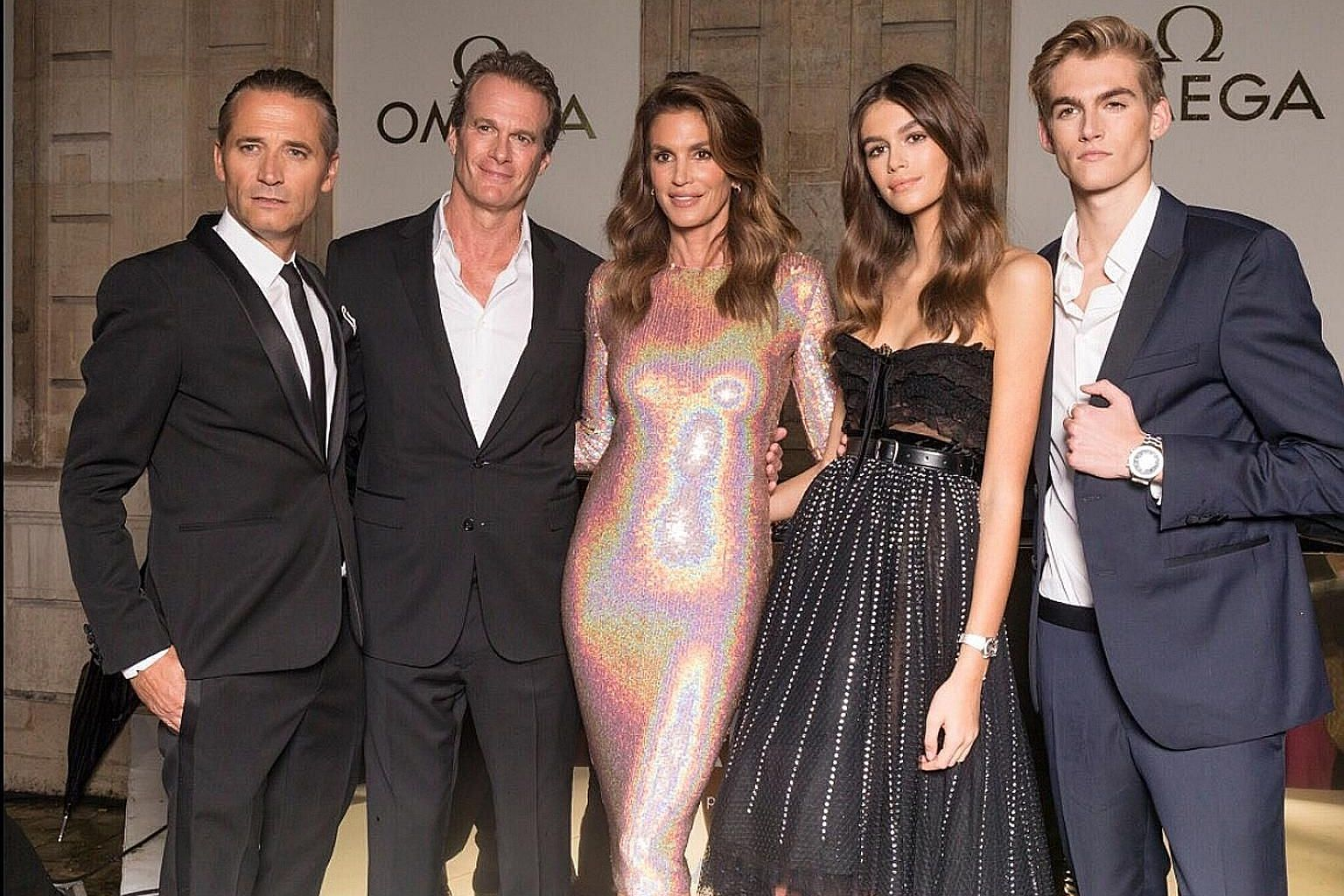 Cindy Crawford (centre) with (from far left) Mr Raynald Aeschlimann, president and chief executive officer of Omega, husband Rande Gerber, daughter Kaia and son Presley at the opening of the Her Time exhibition in Paris recently.