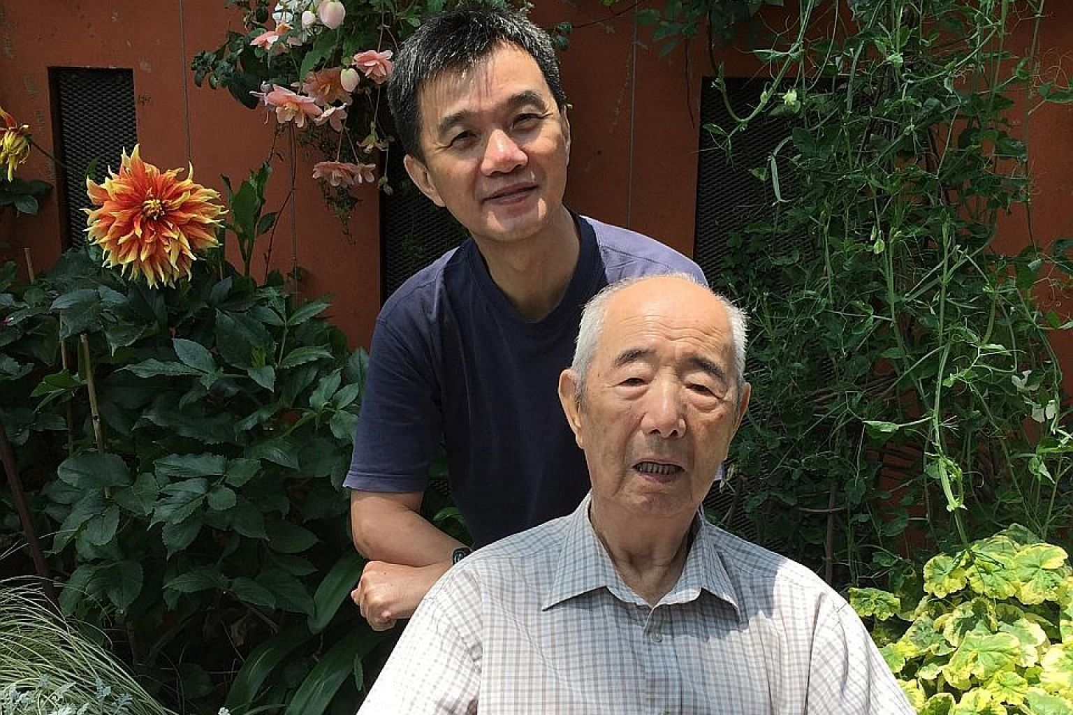 The writer at Gardens by the Bay earlier this year with his father, who is now unconscious and in intensive care at hospital.