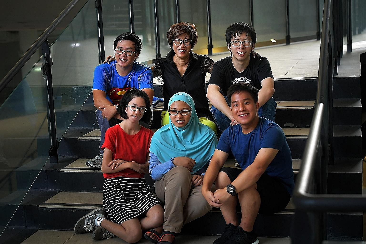 Mrs Tan Shook Wah co-founded The Smart Think, in February this year. The start-up has pioneered a new technology to make lighter, safer and cheaper body armour and helmets. Mrs Tan Shook Wah with some recipients of the Dare to Dream scholarship: (ant