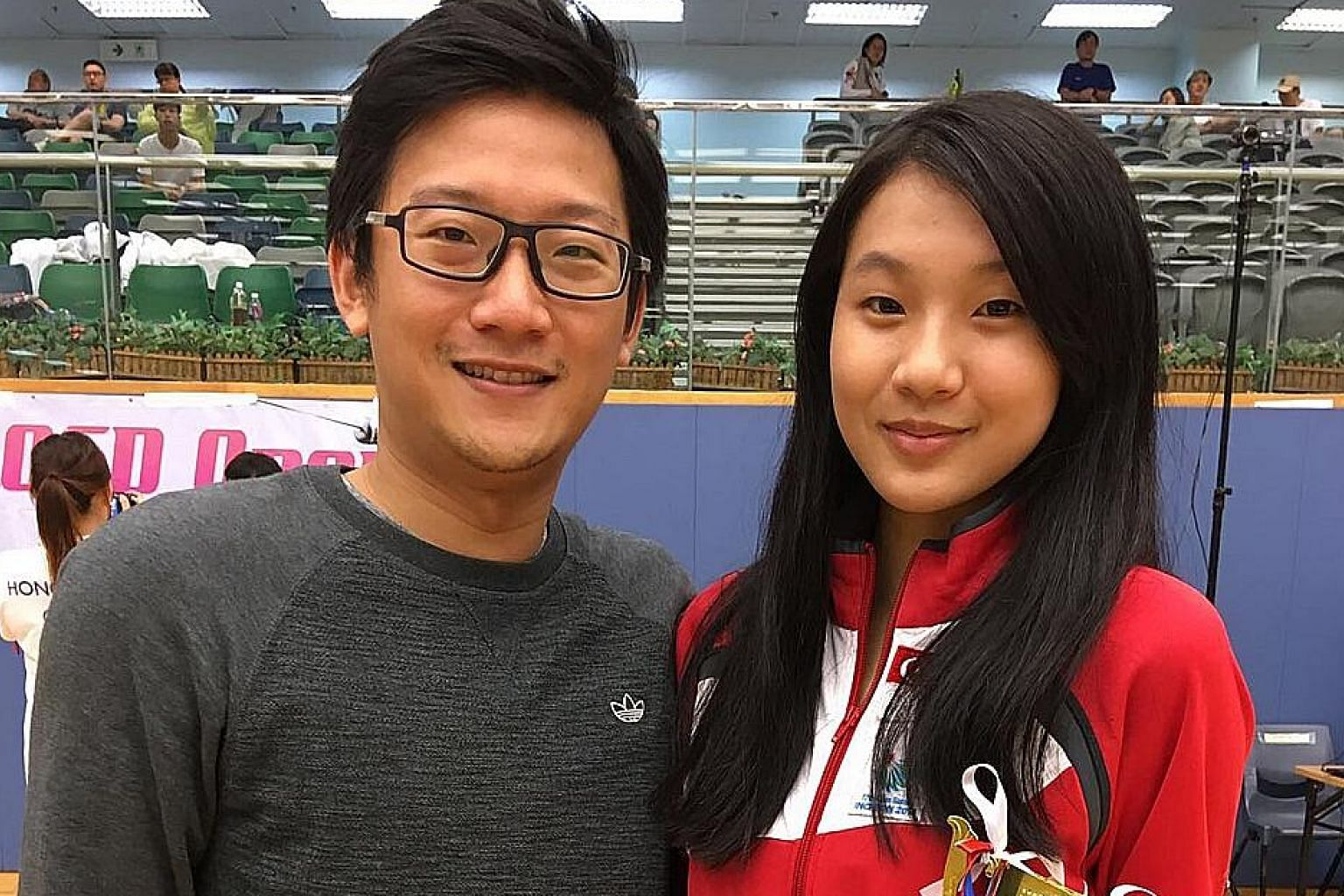 Sabre fencer Lau Ywen with coach David Chan. She has had to switch to a low-intensity style after a stress fracture on her back. Still, she has won a SEA Games gold and now a title in Hong Kong while on the comeback trail.