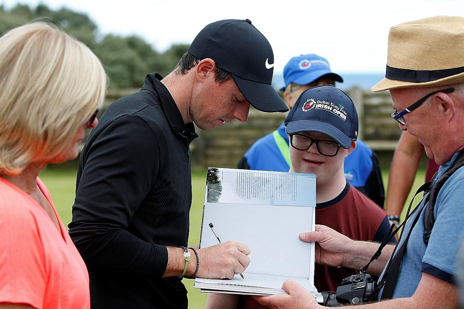 Rory McIlroy signing an autograph in Portstewart, Northern Ireland. The golfer revealed last week that he has disliked Roy Keane ever since the former Irish midfielder turned down his boyhood request for an autograph.
