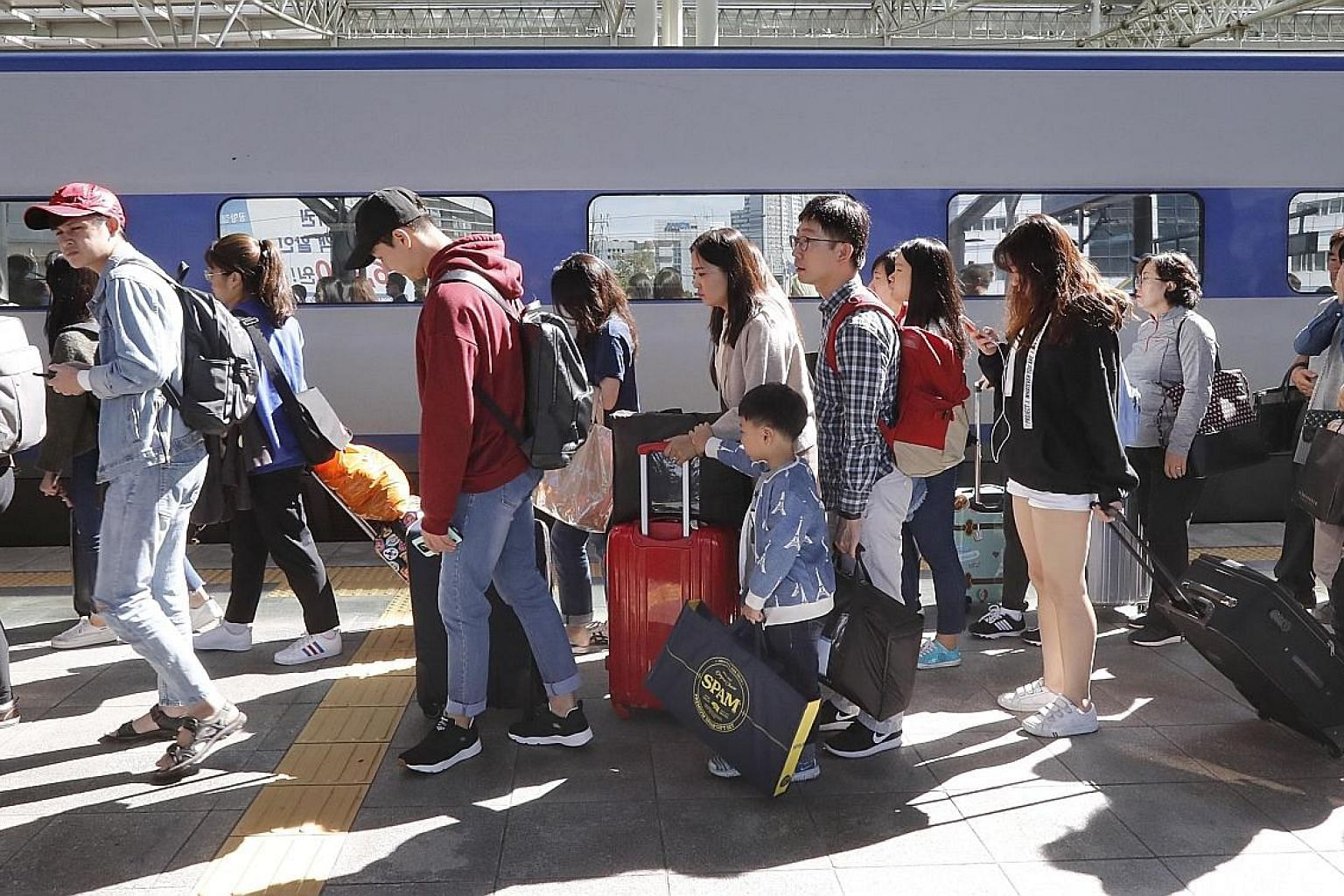 South Koreans at Seoul Station during the Chuseok holiday last Saturday. The long festive period, which began on Sept 30, saw record numbers travel overseas and within the country. The break was also aimed at boosting domestic spending.