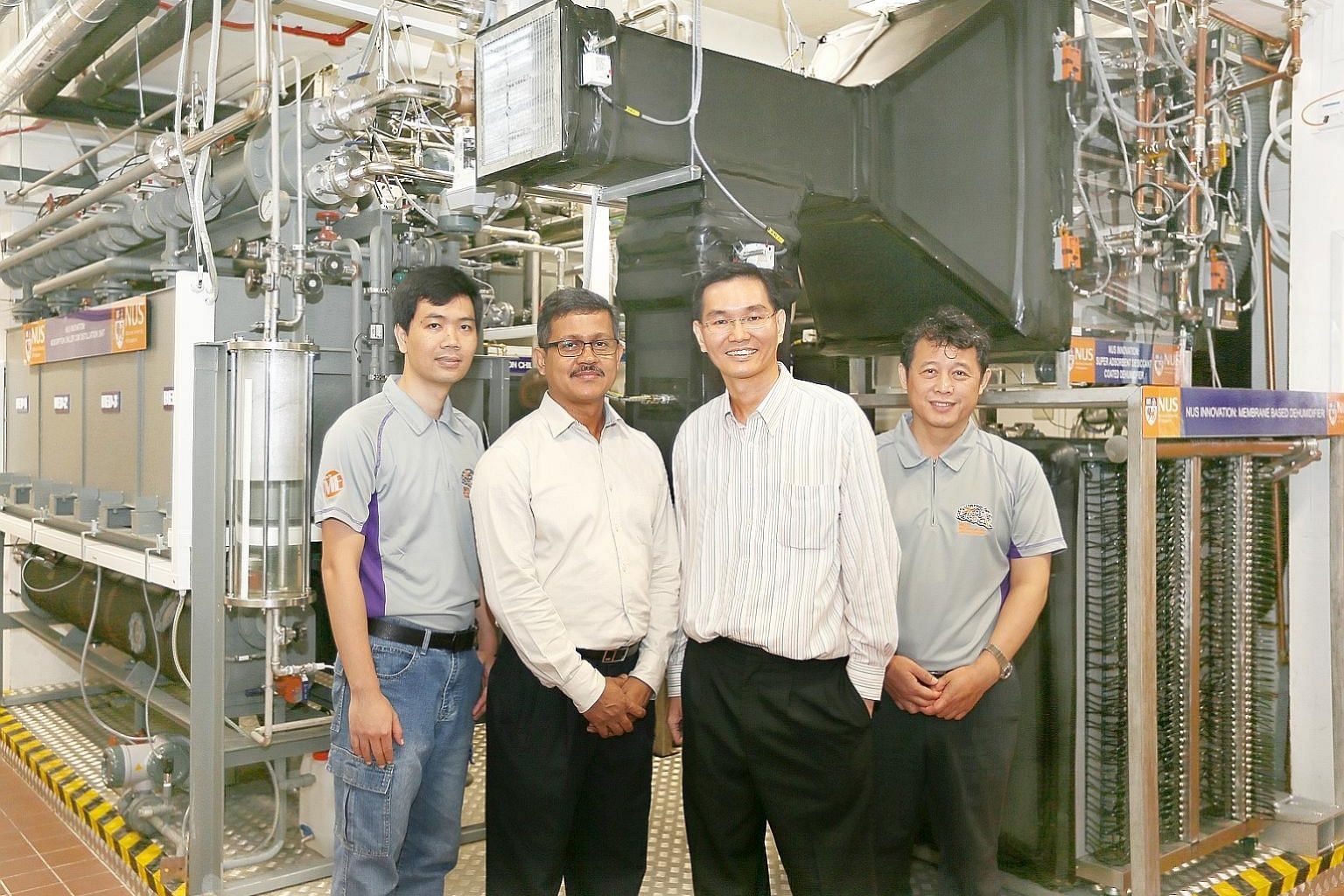 Members of the NUS engineering team behind the quad-generation plant (from left) Dr Bui Duc Thuan, research fellow; Dr Md Raisul Islam, senior lecturer; Associate Professor Ernest Chua; and Dr M Kum Ja, senior research fellow.