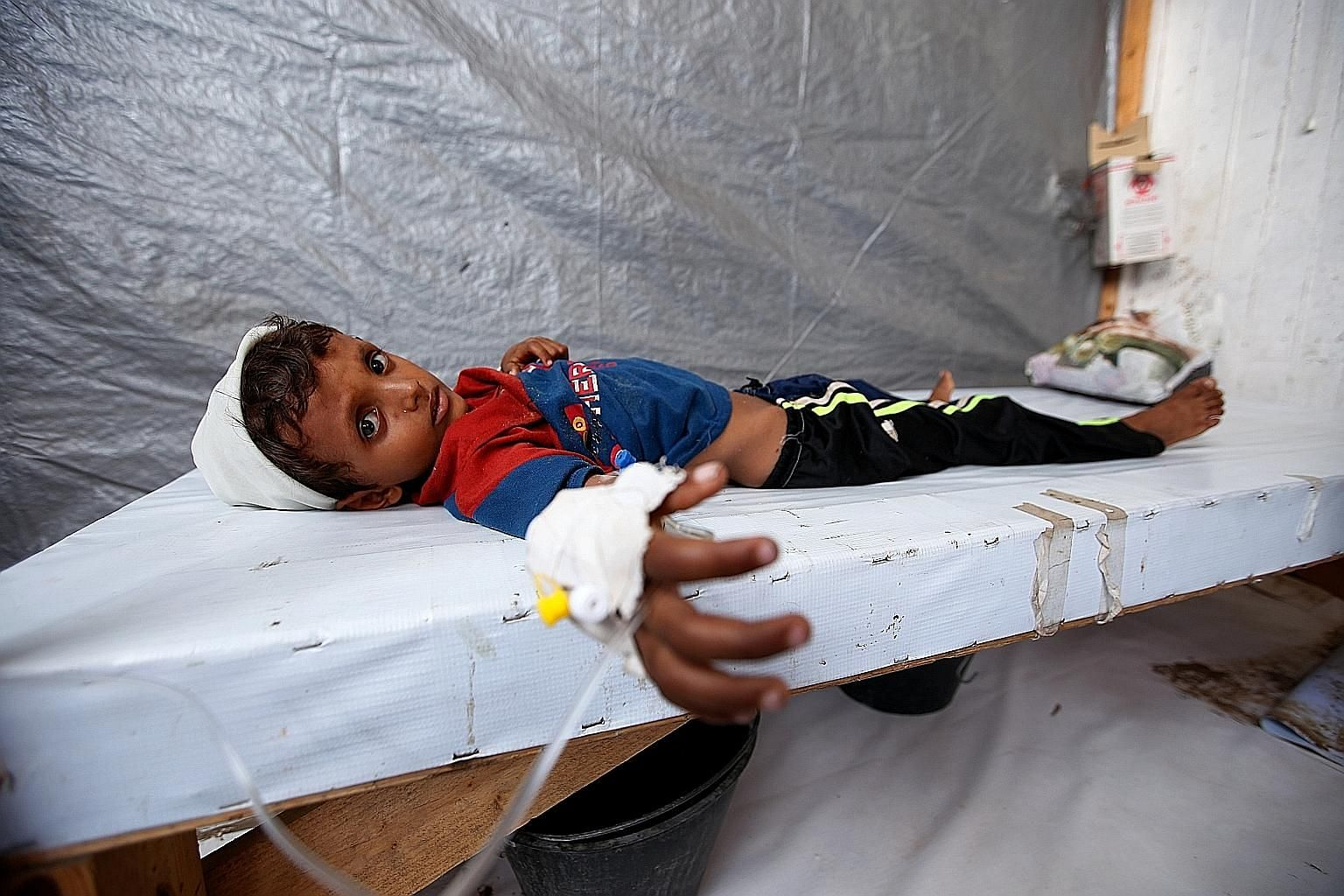 Cholera-stricken Siddique Nuruddin Ali, seven, at a treatment centre in the Red Sea port city of Hodeidah last Sunday. The cholera outbreak in war-torn Yemen is the largest single-year cholera outbreak on record, United Nations spokesman Stephane Duj