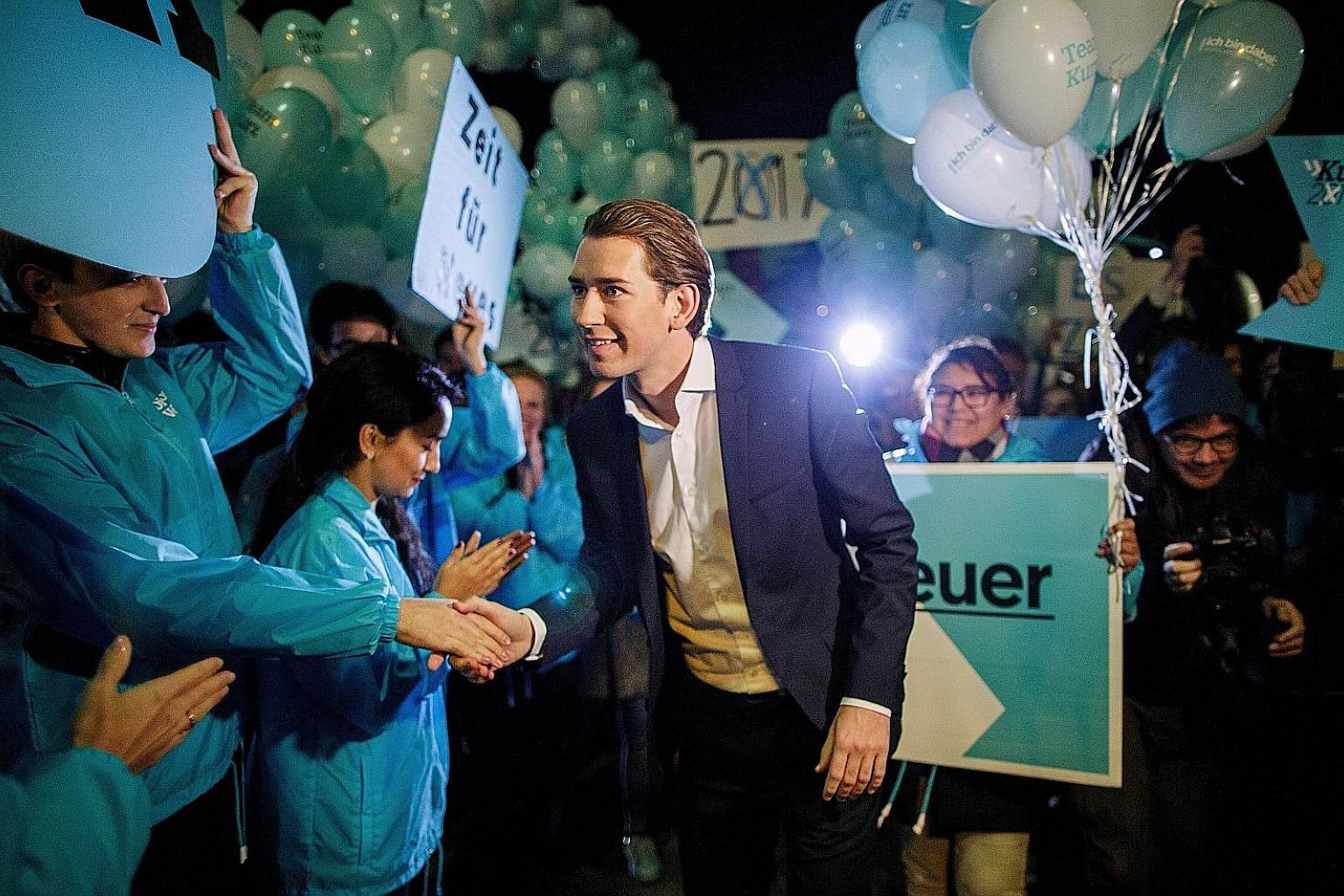 Mr Sebastian Kurz, who became Austria's foreign minister at the age of 27, greeting supporters in Vienna last Tuesday. The leader of the centre-right Austrian People's Party will have to reassure the migrant population that he can pull back from the