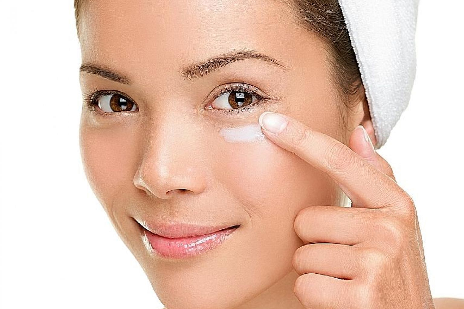 Use your fingers to apply eye cream in a rolling circular motion under the eye, from the nose bridge towards the temple, to improve lymphatic drainage and ease puffiness.