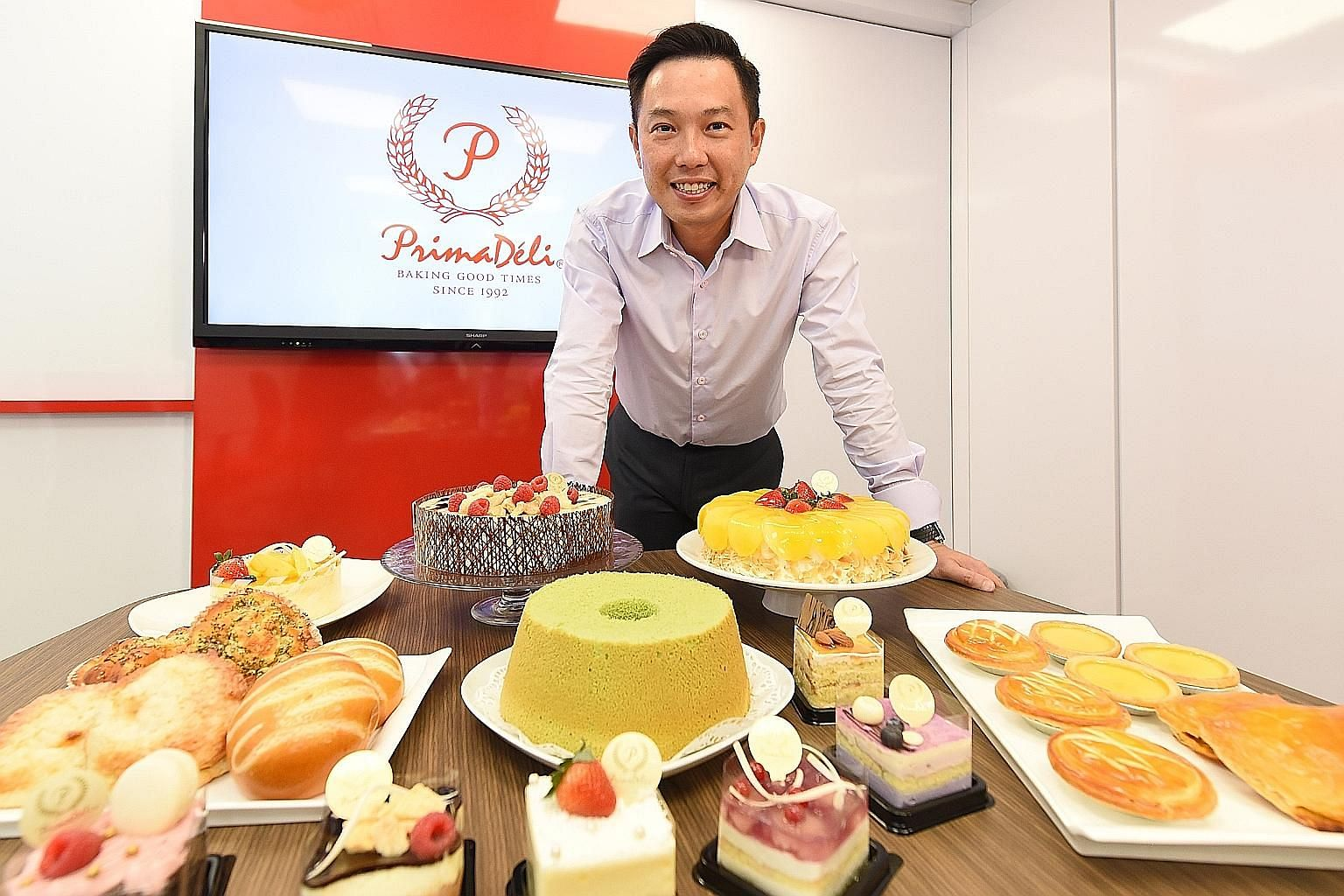 PrimaDeli general manager George Lim with some of the products made by the firm that are sold by its franchisees. The company's franchise model differed from others in that the idea was for existing bakeries to take on the PrimaDeli brand and sell pr