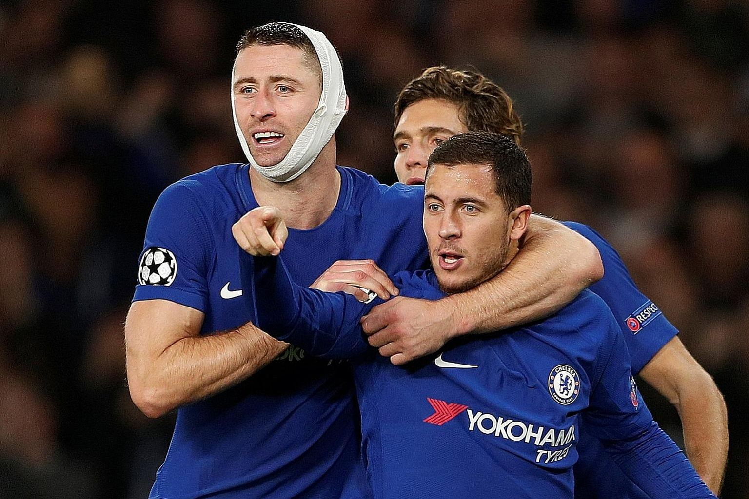 Chelsea's Eden Hazard (front) celebrating his 75th-minute equaliser against Roma with captain Gary Cahill and Marcos Alonso, which gave the Blues a point on Wednesday. They threw away a two-goal lead, and with two league losses in a row and N'Golo Ka